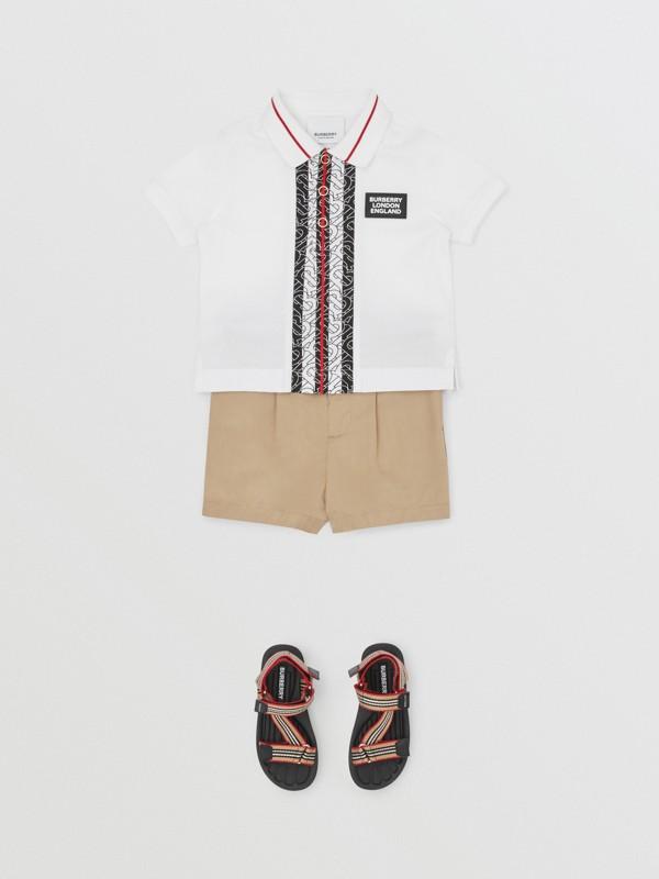Monogram Stripe Cotton Piqué Polo Shirt in White - Children   Burberry - cell image 2