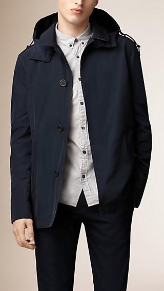 Veste à capuche amovible en tissu technique