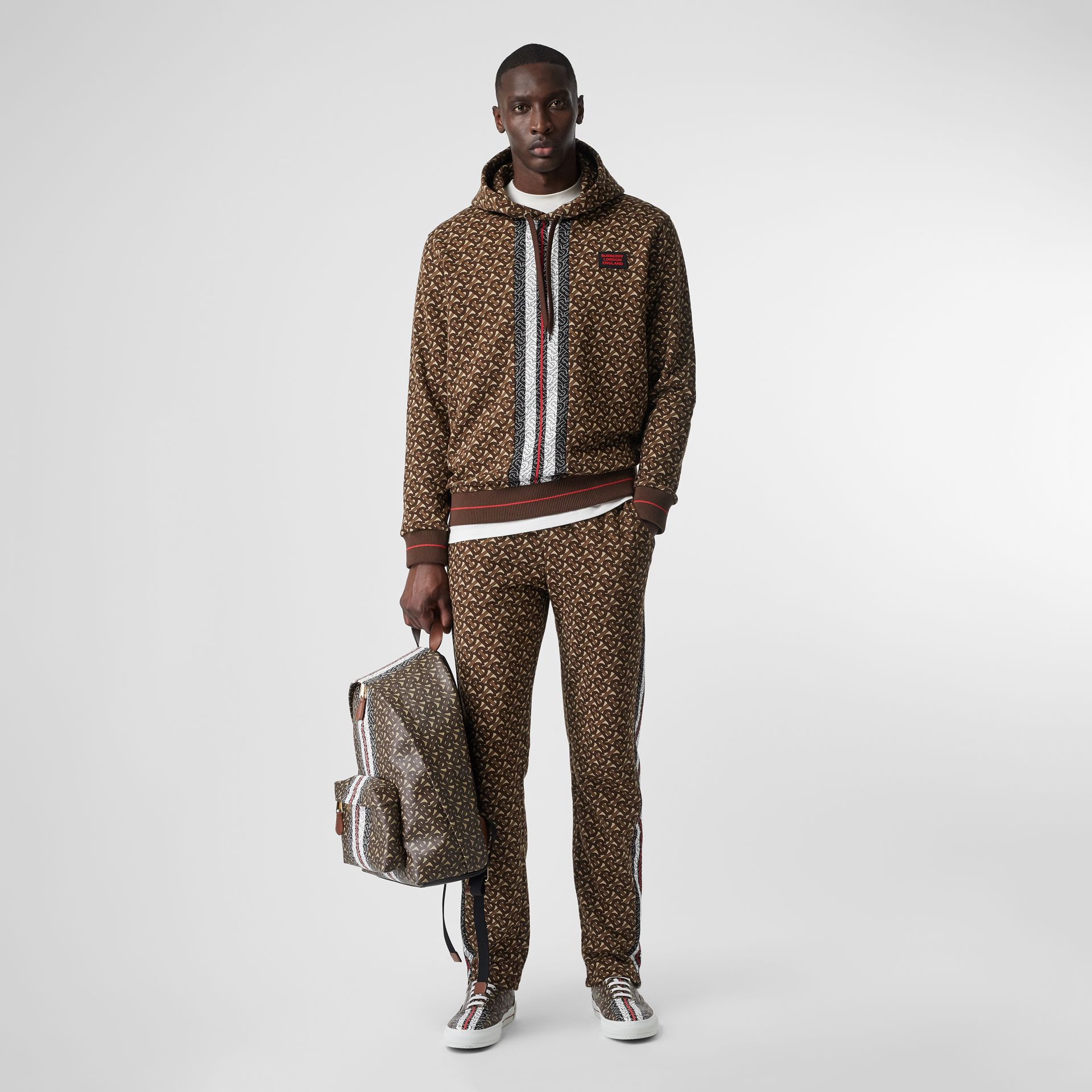 Monogram Stripe Print Cotton Trackpants in Bridle Brown - Men | Burberry - gallery image 0