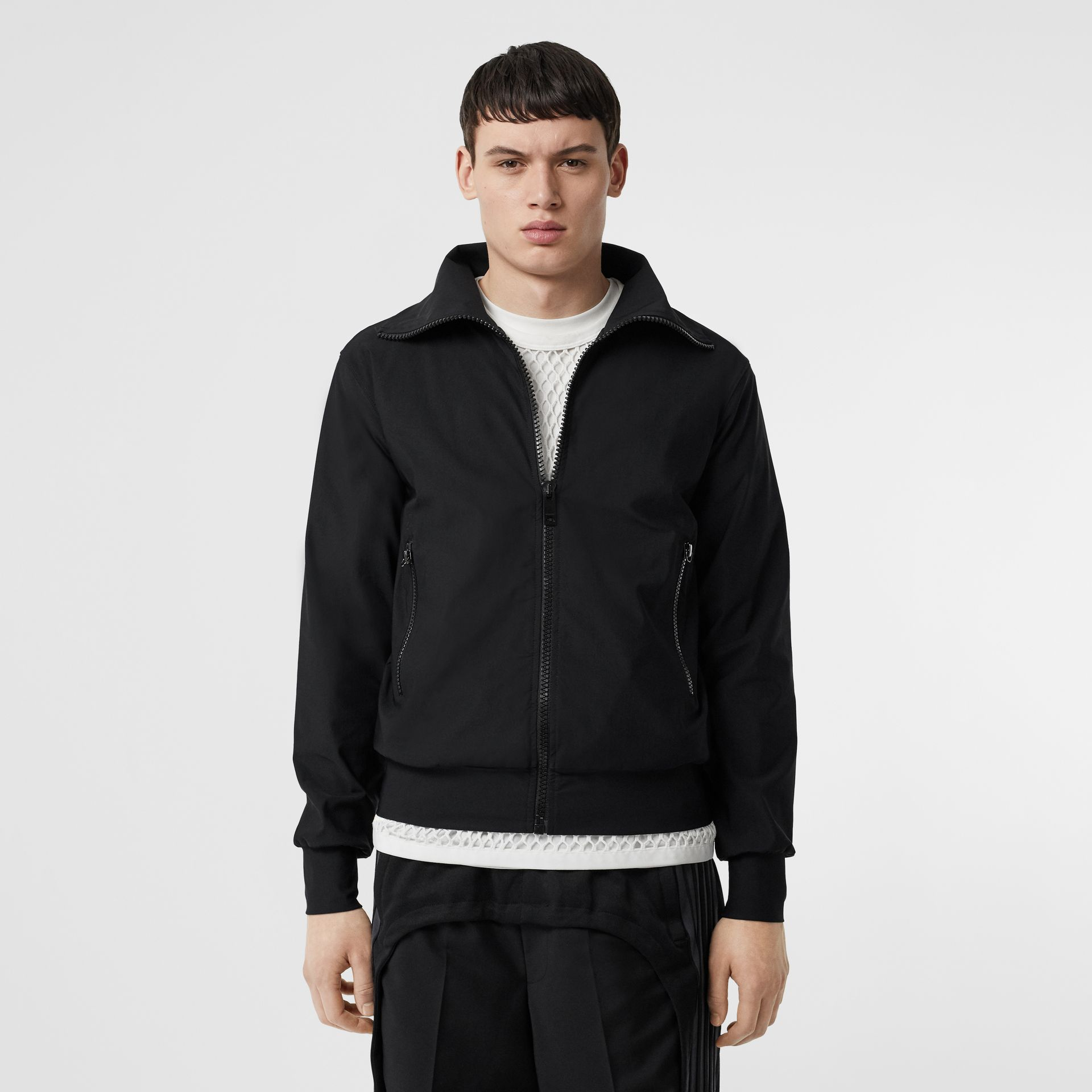 Logo Print Funnel Neck Track Top in Black - Men | Burberry United Kingdom - gallery image 1