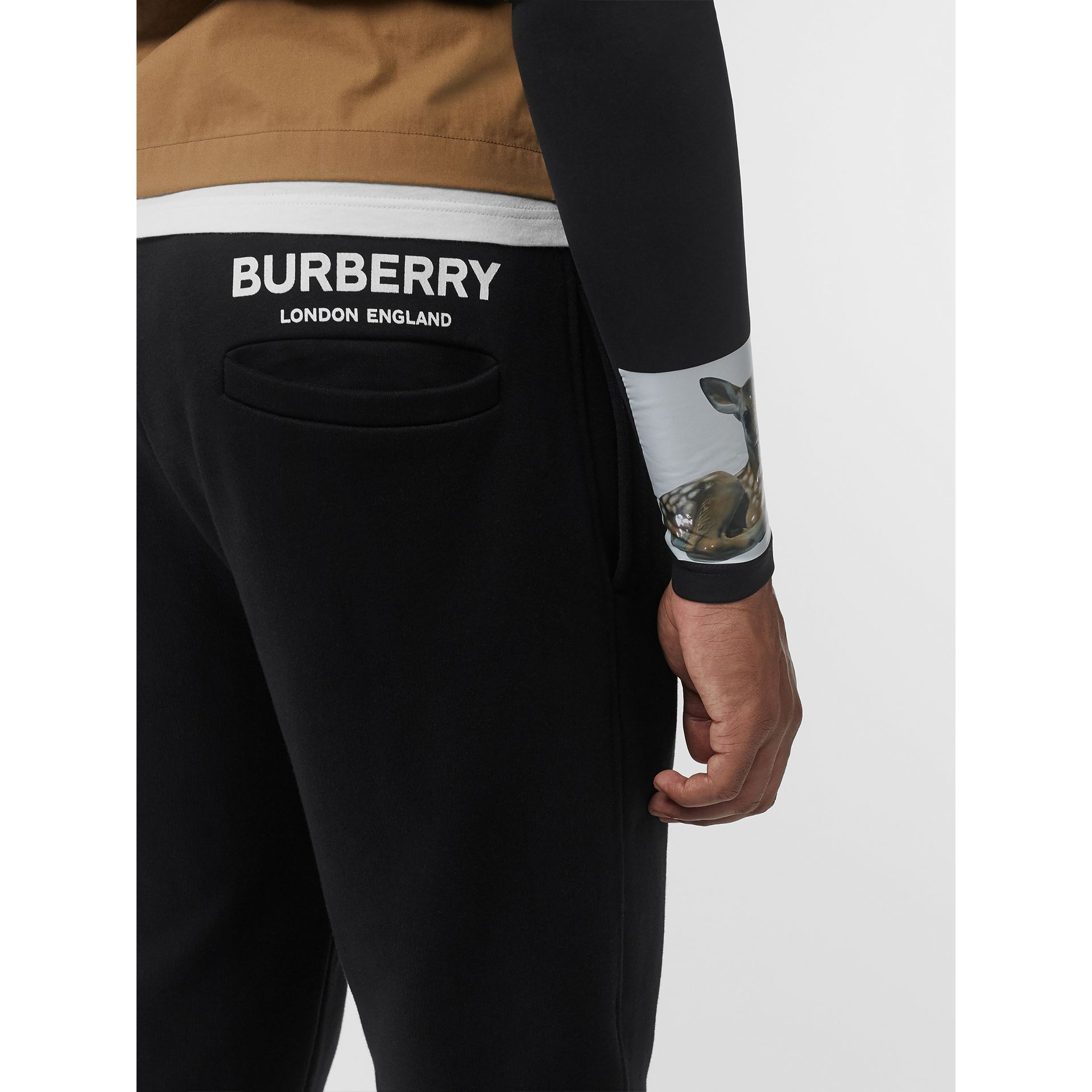 Logo Print Cotton Trackpants in Black - Men | Burberry United States - gallery image 1