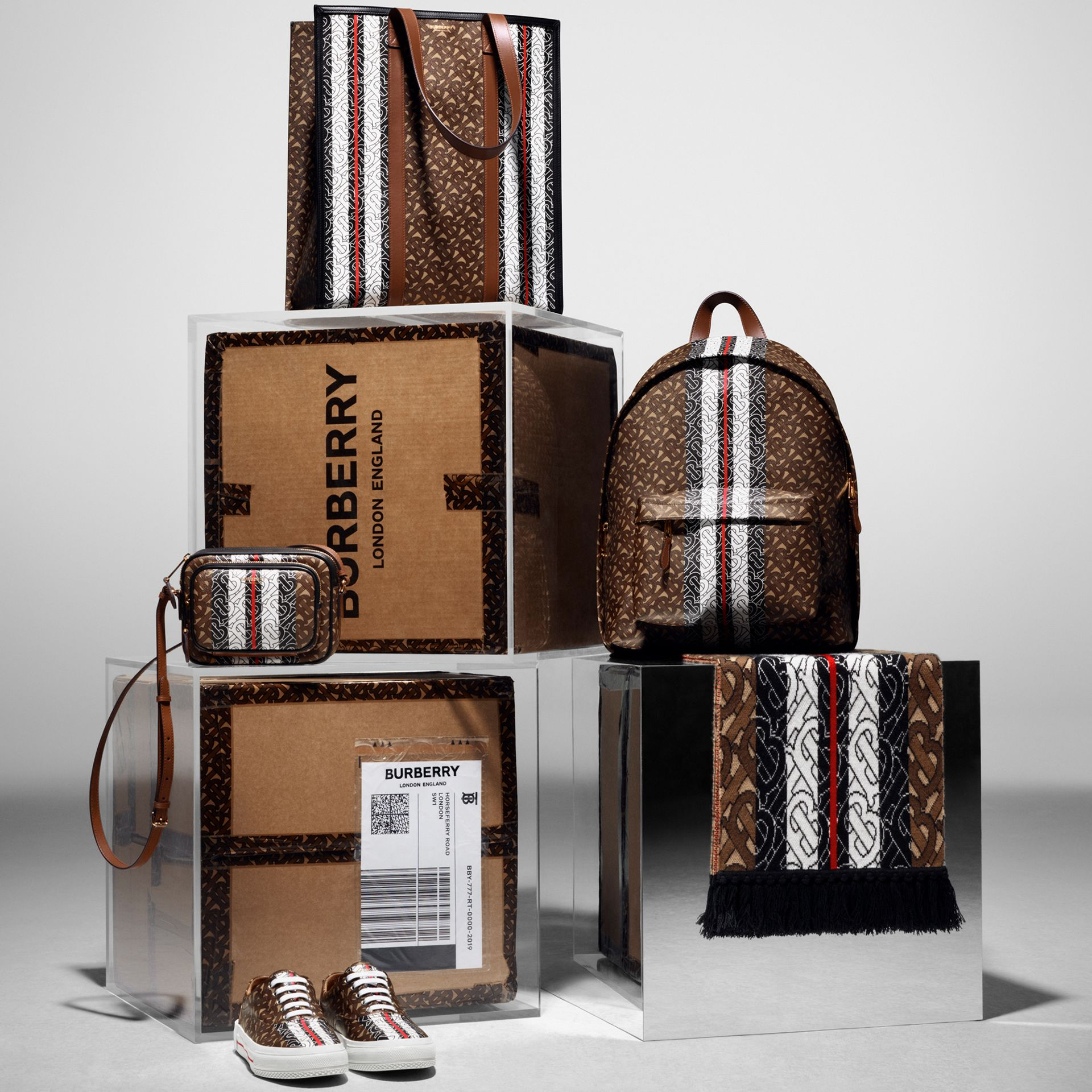 Monogram Stripe Print E-canvas Backpack in Bridle Brown | Burberry Australia - gallery image 1
