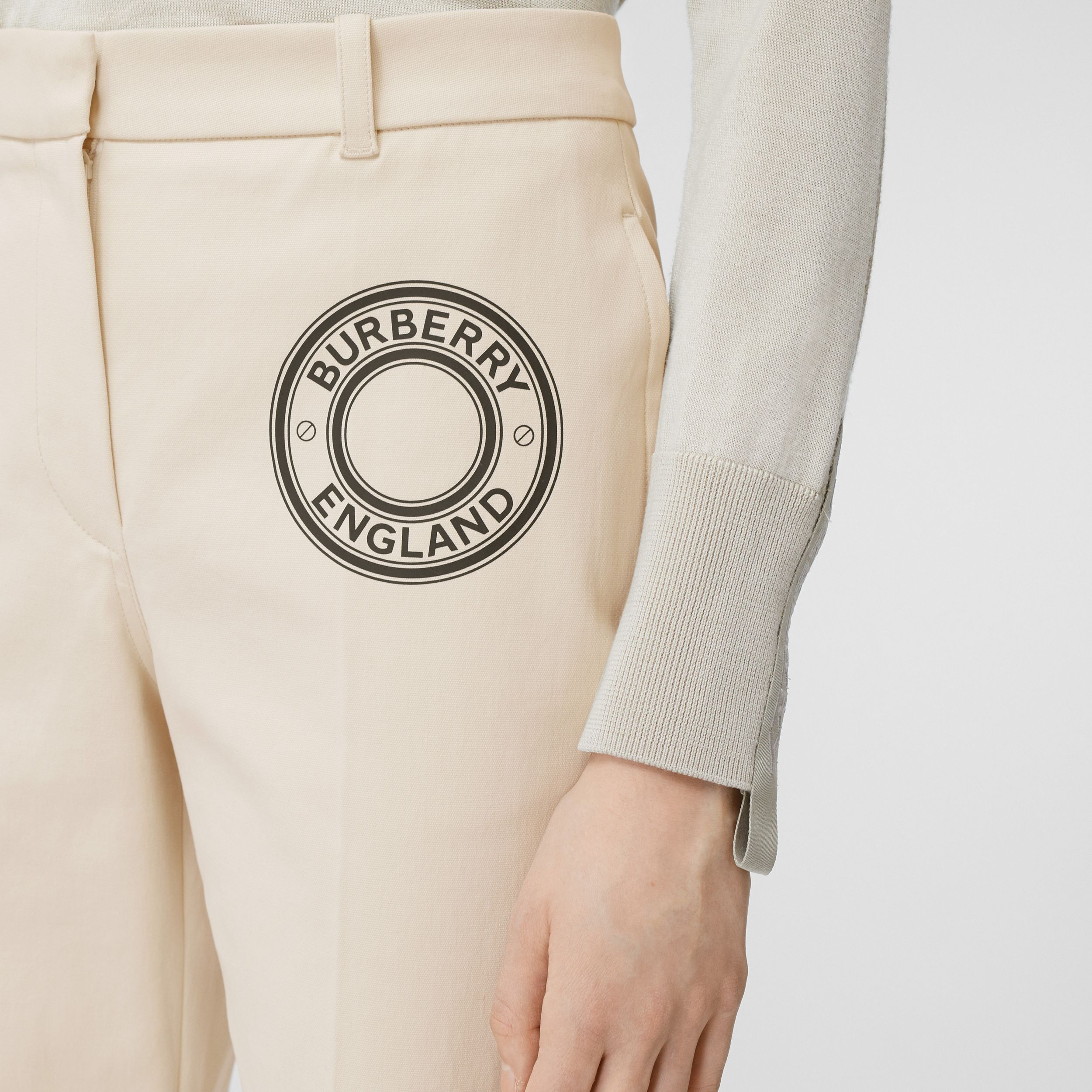 Logo Graphic Stretch Cotton Canvas Tailored Trousers in Pale Cream - Women | Burberry - 2