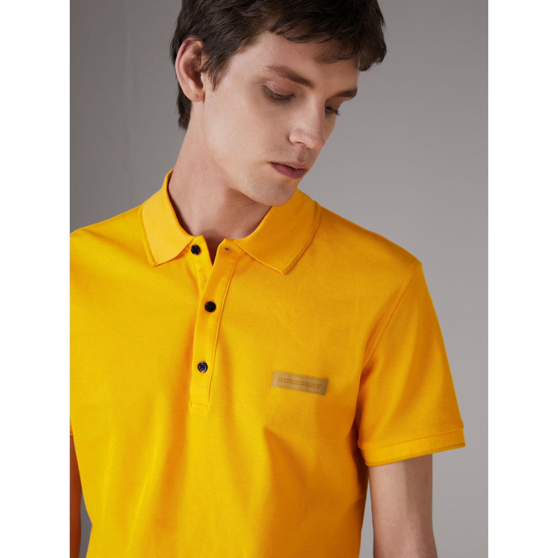 Cotton Piqué Polo Shirt in Bright Yellow - Men | Burberry Australia - gallery image 1