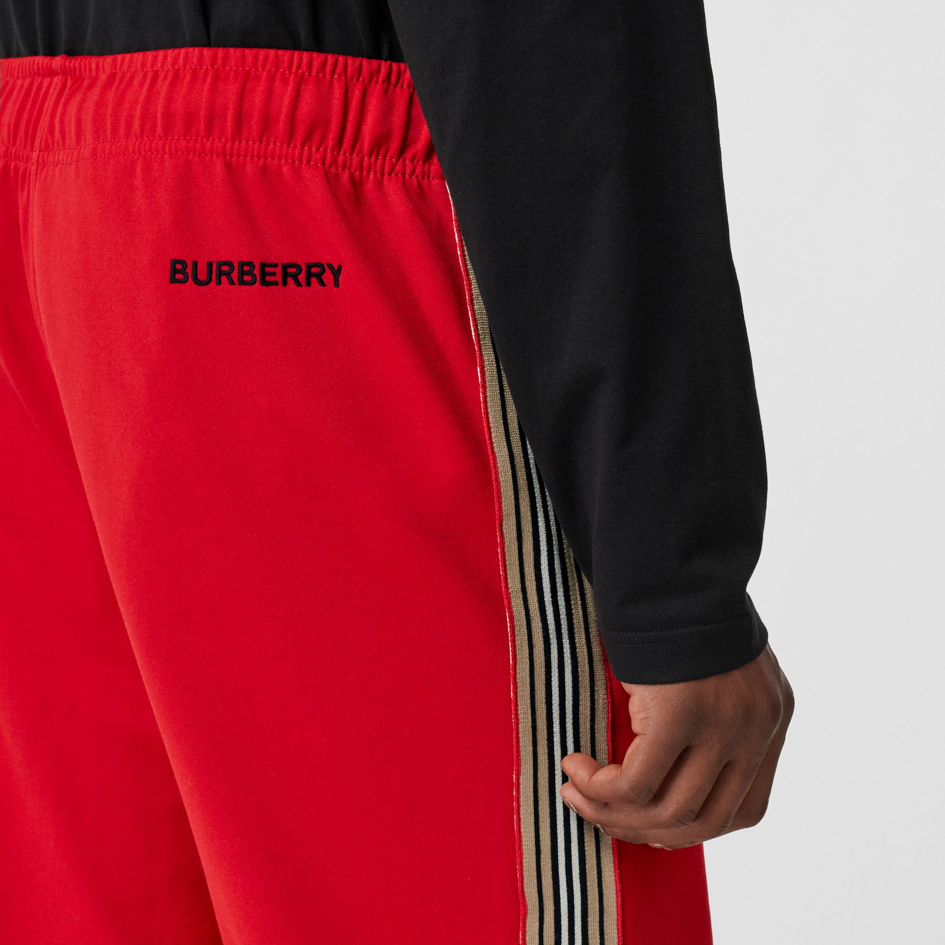 Icon Stripe Detail Jersey Trackpants in Bright Red - Men | Burberry - gallery image 1