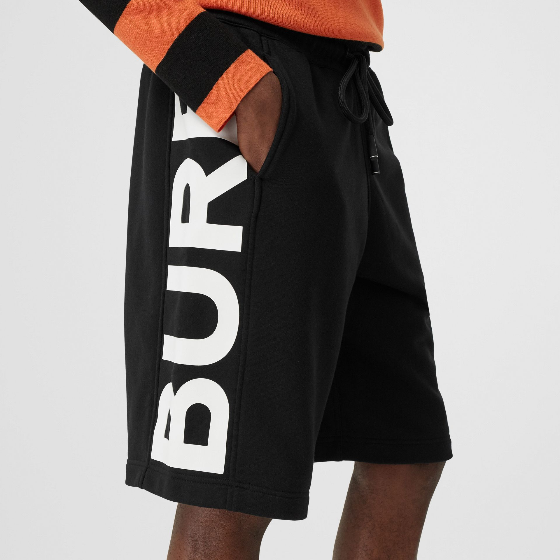 Logo Print Cotton Drawcord Shorts in Black | Burberry United Kingdom - gallery image 1