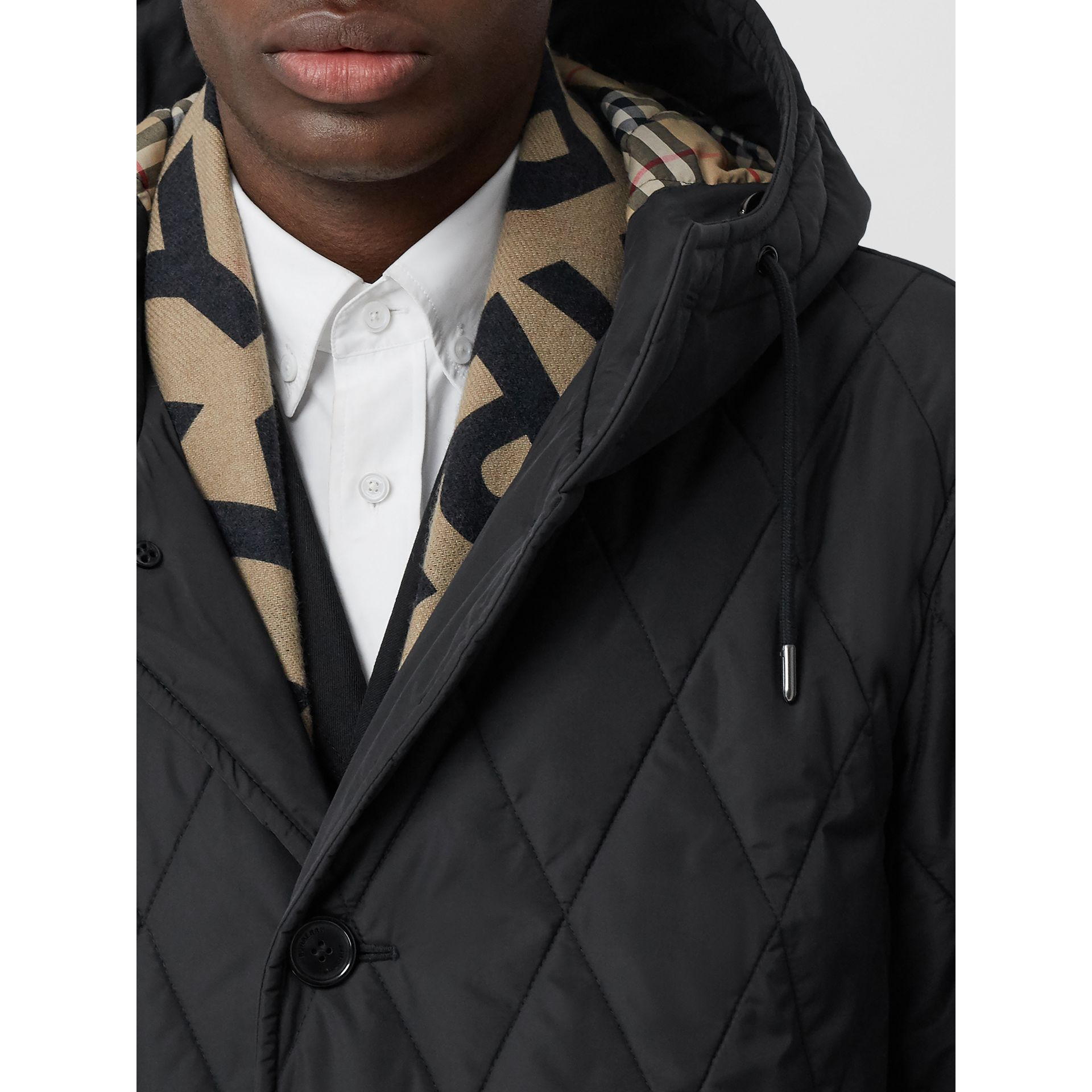 Diamond Quilted Thermoregulated ECONYL® Coat in Black - Men | Burberry United Kingdom - gallery image 1