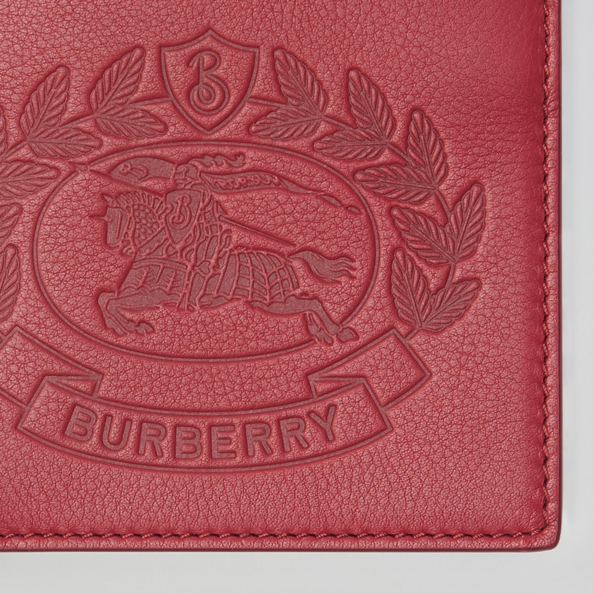 Embossed Crest Leather International Bifold Wallet in Crimson - Men | Burberry Australia - gallery image 1