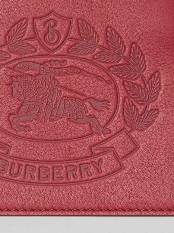 Embossed Crest Leather International Bifold Wallet in Crimson - Men | Burberry Australia - cell image 1