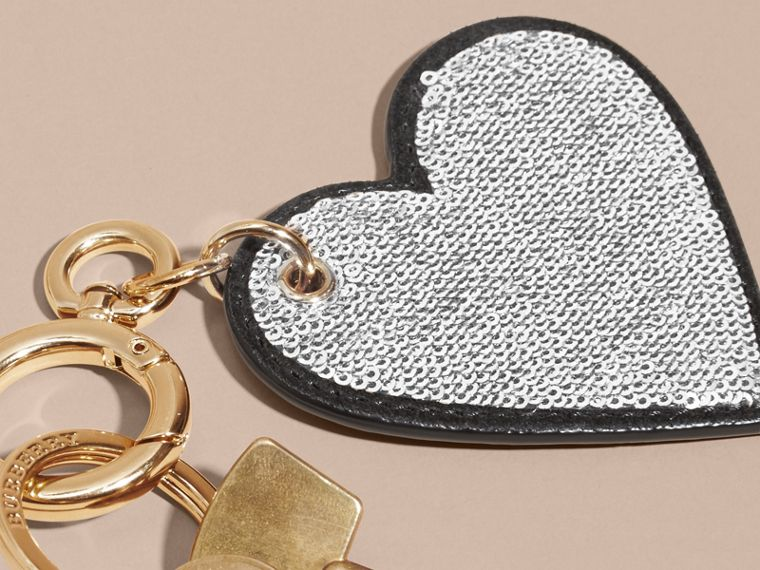 Sequinned Heart Key Charm in White/black - cell image 1