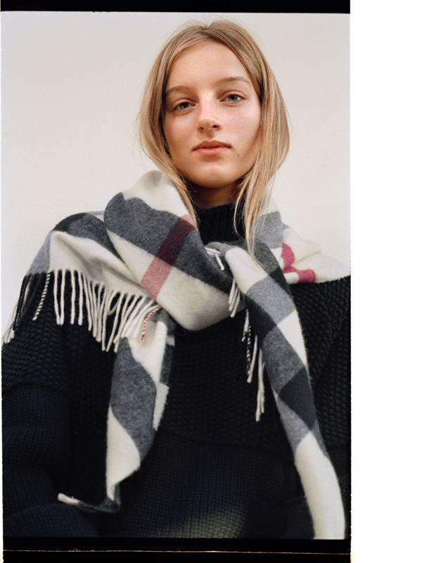 Hebe loosely knots The Burberry Bandana over the shoulders.