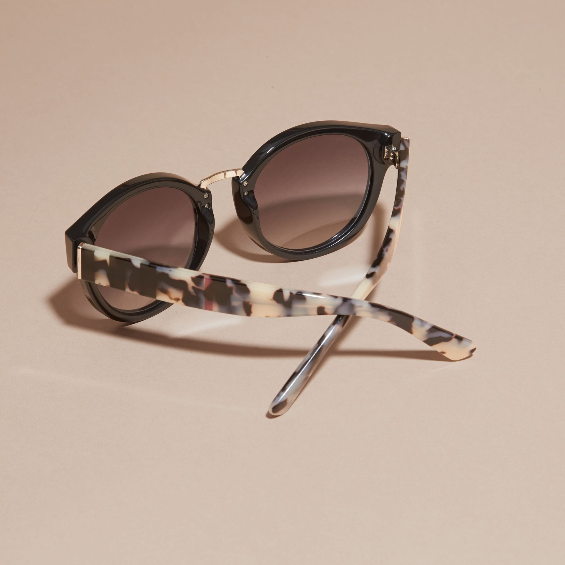 Check and Camouflage Detail Round Frame Sunglasses in Black - Women | Burberry - gallery image 4