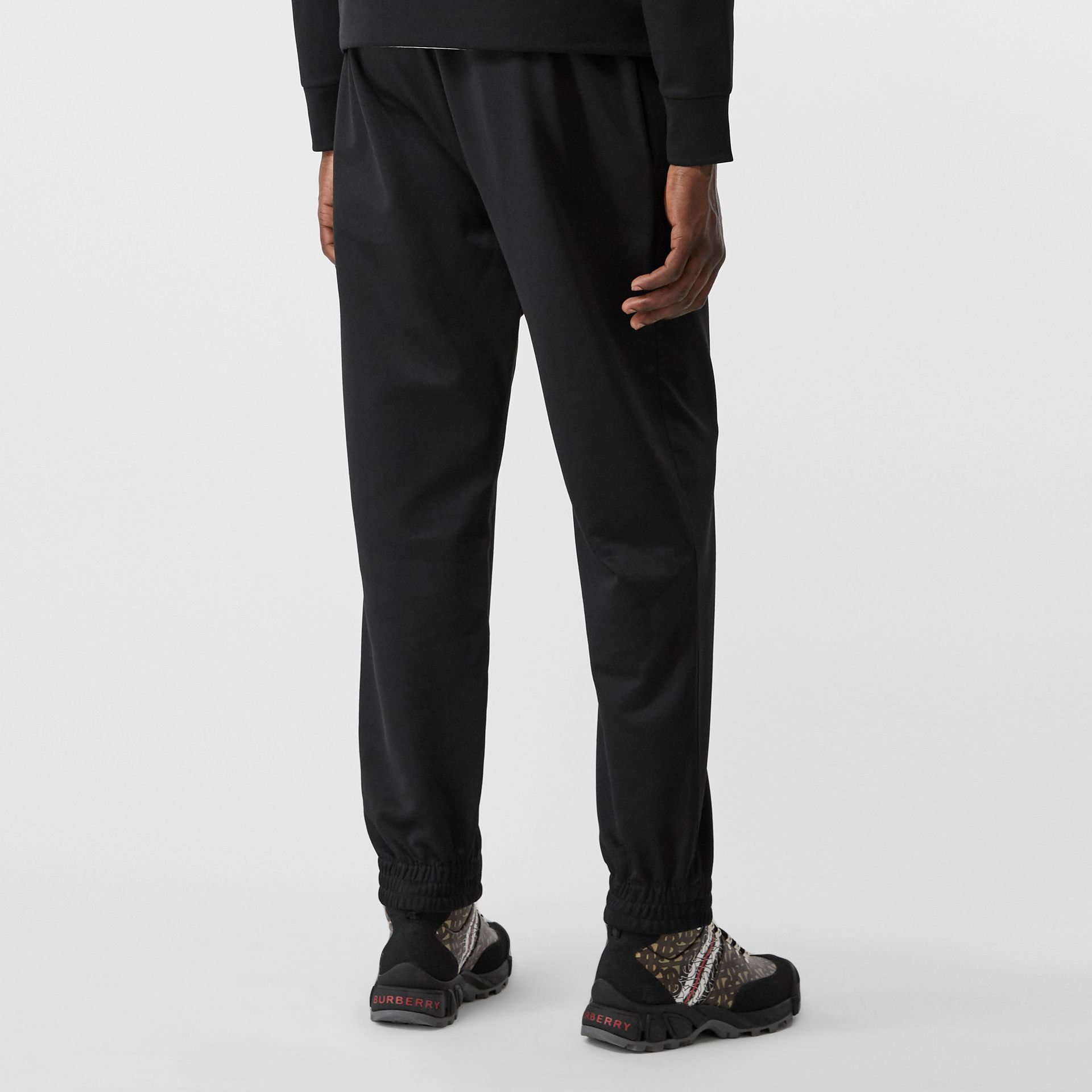 Logo Graphic Jersey Trackpants in Black - Men | Burberry - gallery image 2
