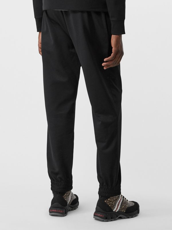 Logo Graphic Jersey Trackpants in Black - Men | Burberry - cell image 2