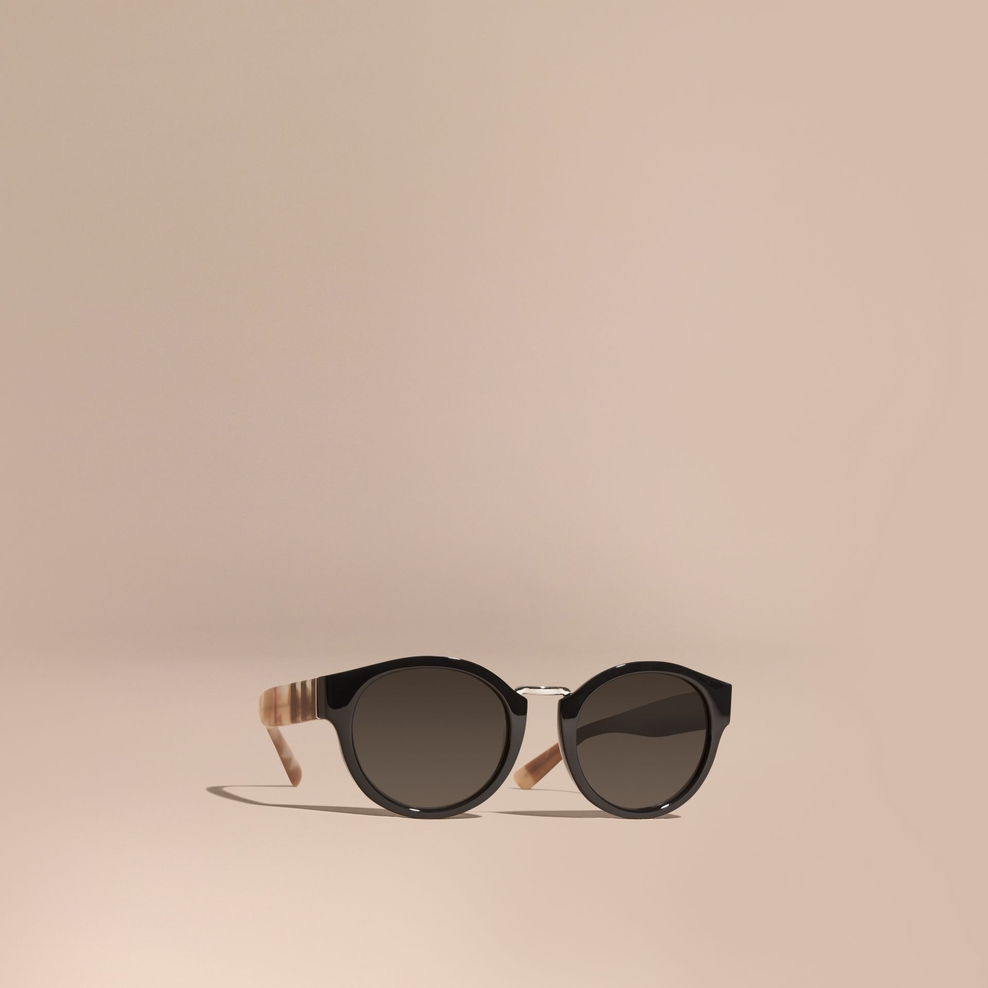 Check and Camouflage Detail Round Frame Sunglasses in Black - Women | Burberry - gallery image 1