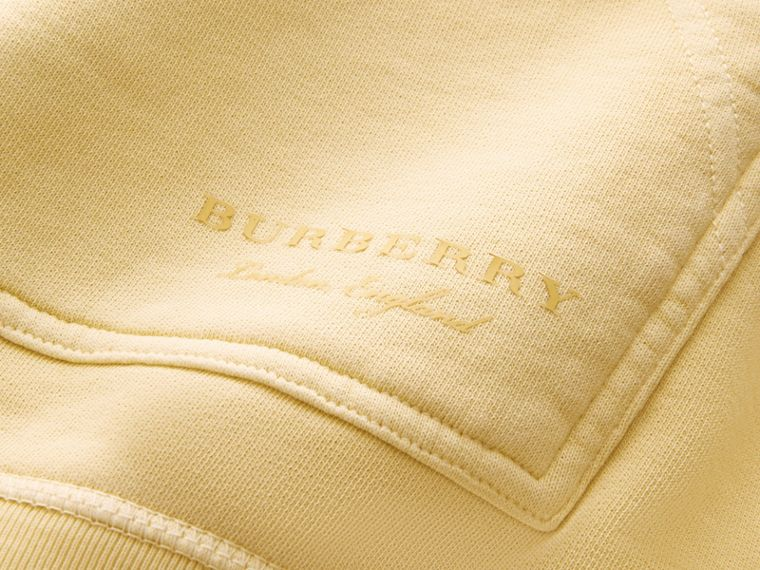 Unisex Pigment-dyed Cotton Oversize Sweatshirt in Pale Yellow - Men | Burberry Hong Kong - cell image 1