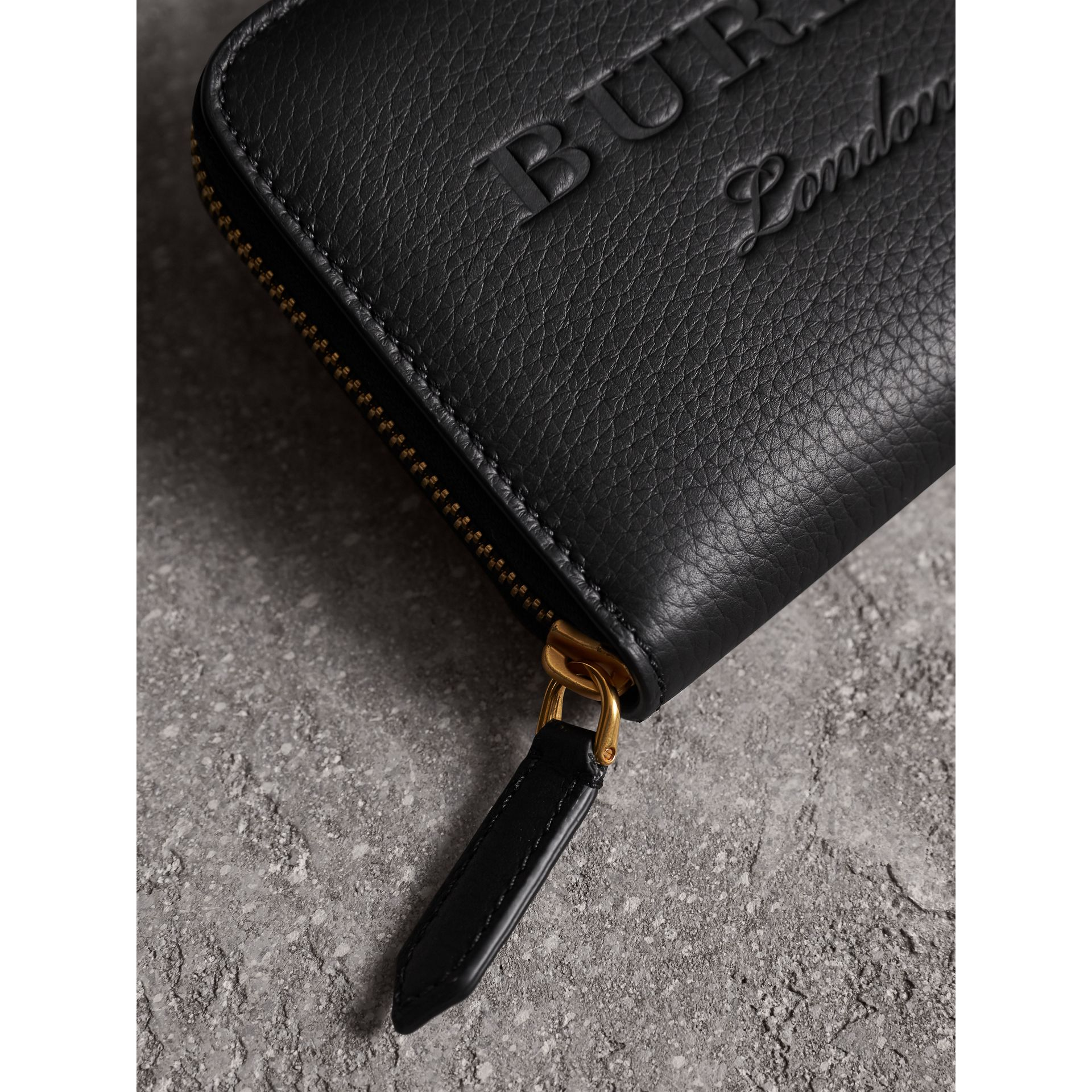 Embossed Leather Ziparound Wallet in Black | Burberry - gallery image 1