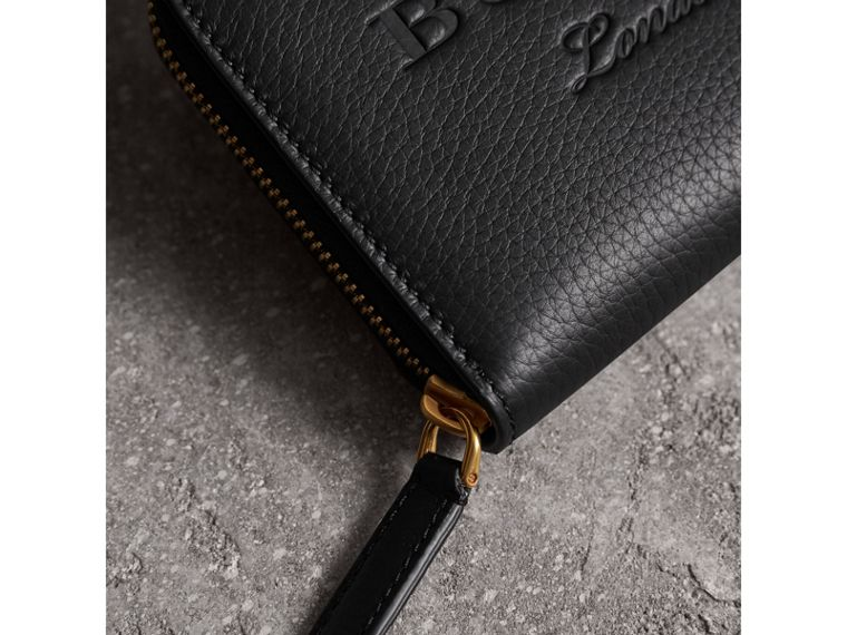 Embossed Leather Ziparound Wallet in Black - Women | Burberry Australia - cell image 1