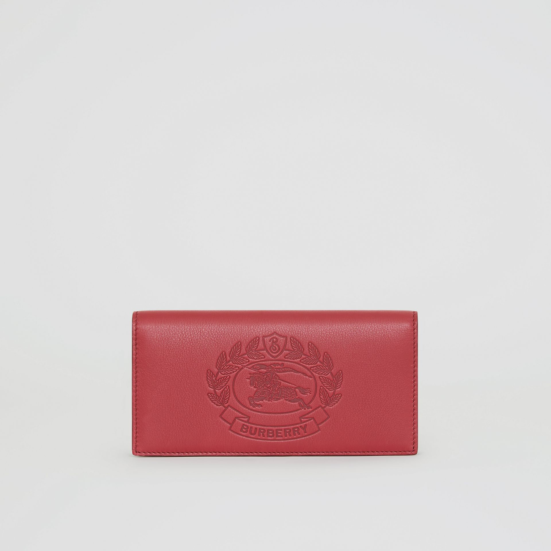 Embossed Crest Leather Continental Wallet in Crimson - Men | Burberry United Kingdom - gallery image 0
