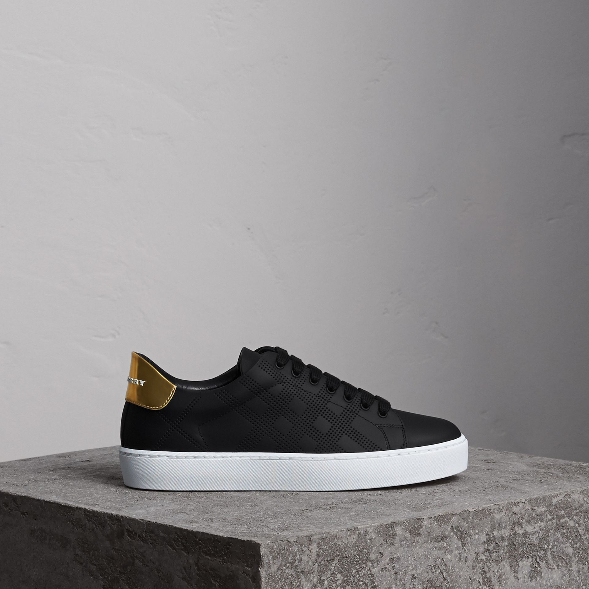 Perforated Check Leather Sneakers in Black - Women | Burberry - gallery image 0
