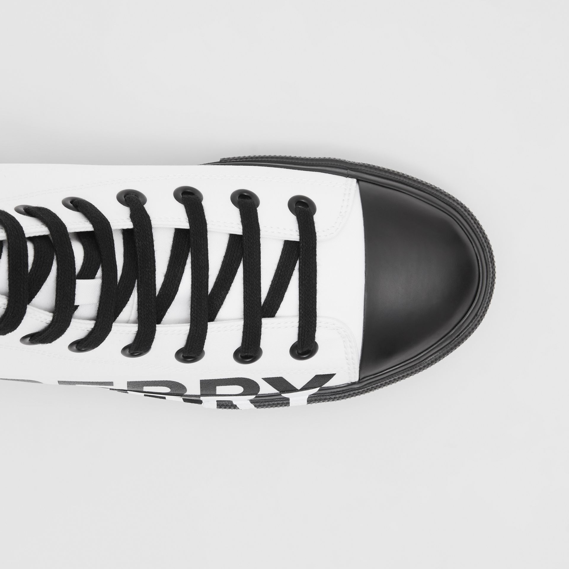 Logo Print Cotton Gabardine High-top Sneakers in Optic White/black - Men | Burberry - gallery image 1