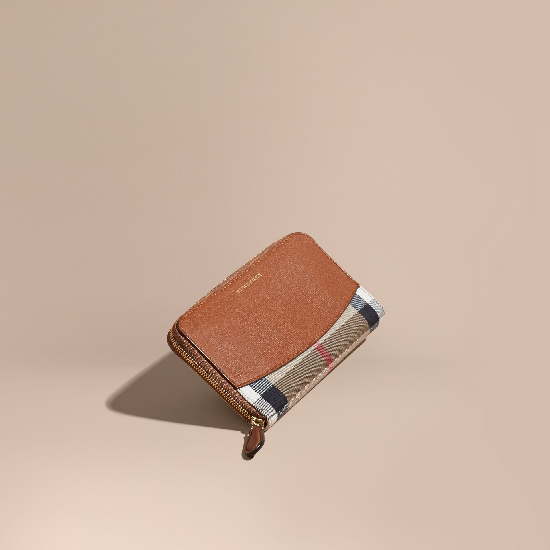 House Check and Leather Ziparound Wallet in Brown Ochre - Women | Burberry Singapore - gallery image 1