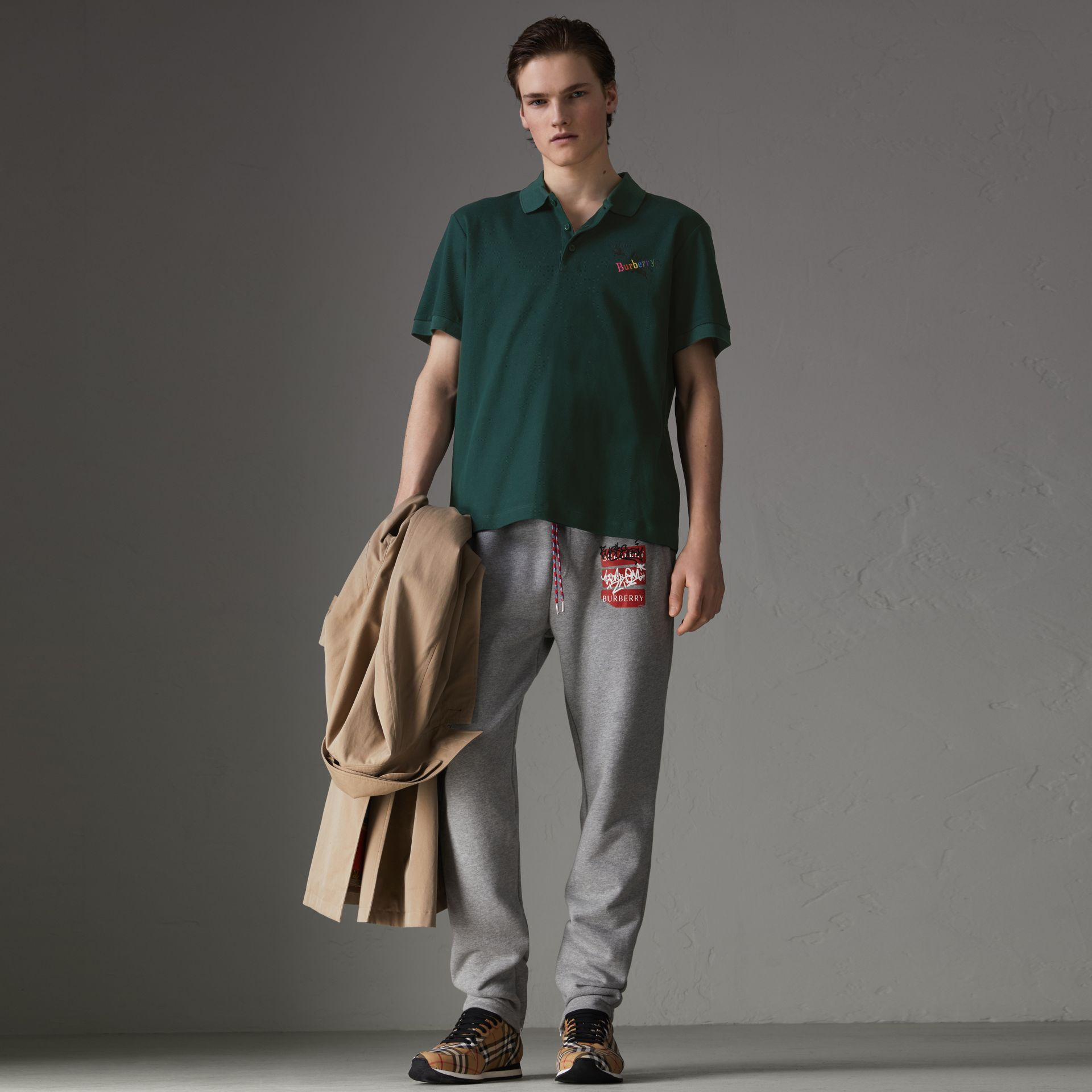 Triple Archive Logo Cotton Piqué Polo Shirt in Dark Forest Green - Men | Burberry Australia - gallery image 0