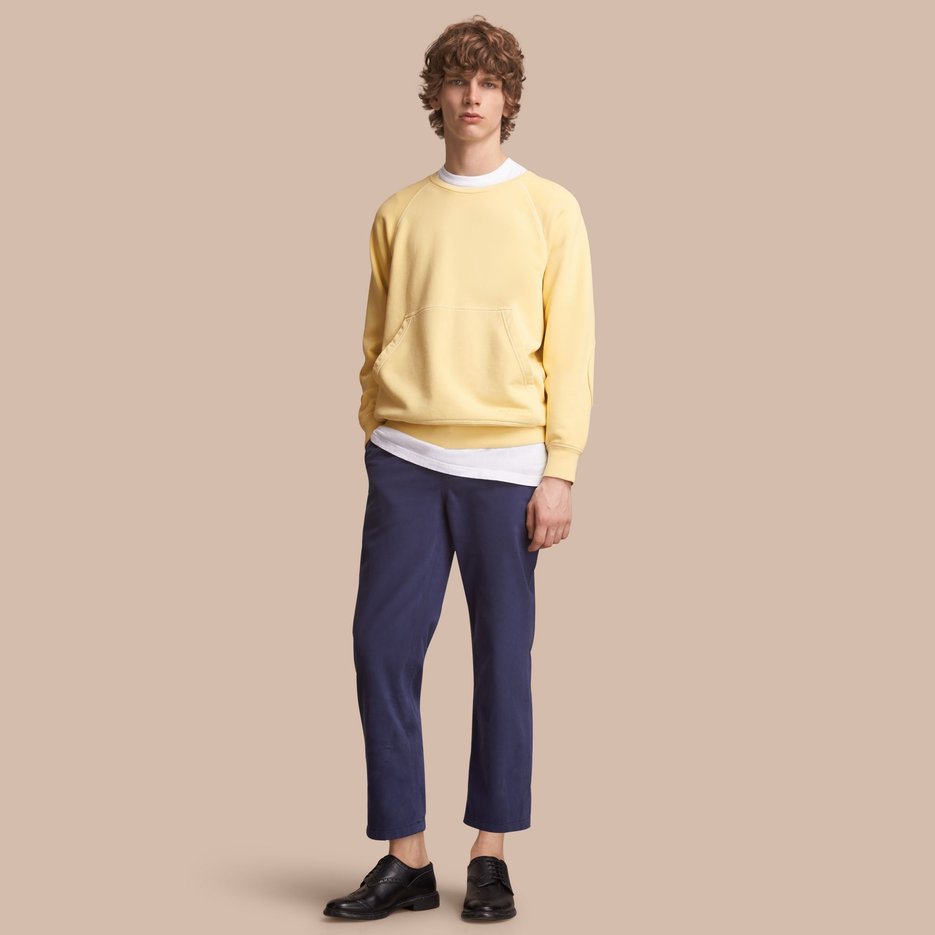 Unisex Pigment-dyed Cotton Oversize Sweatshirt in Pale Yellow - Men | Burberry Hong Kong - gallery image 1
