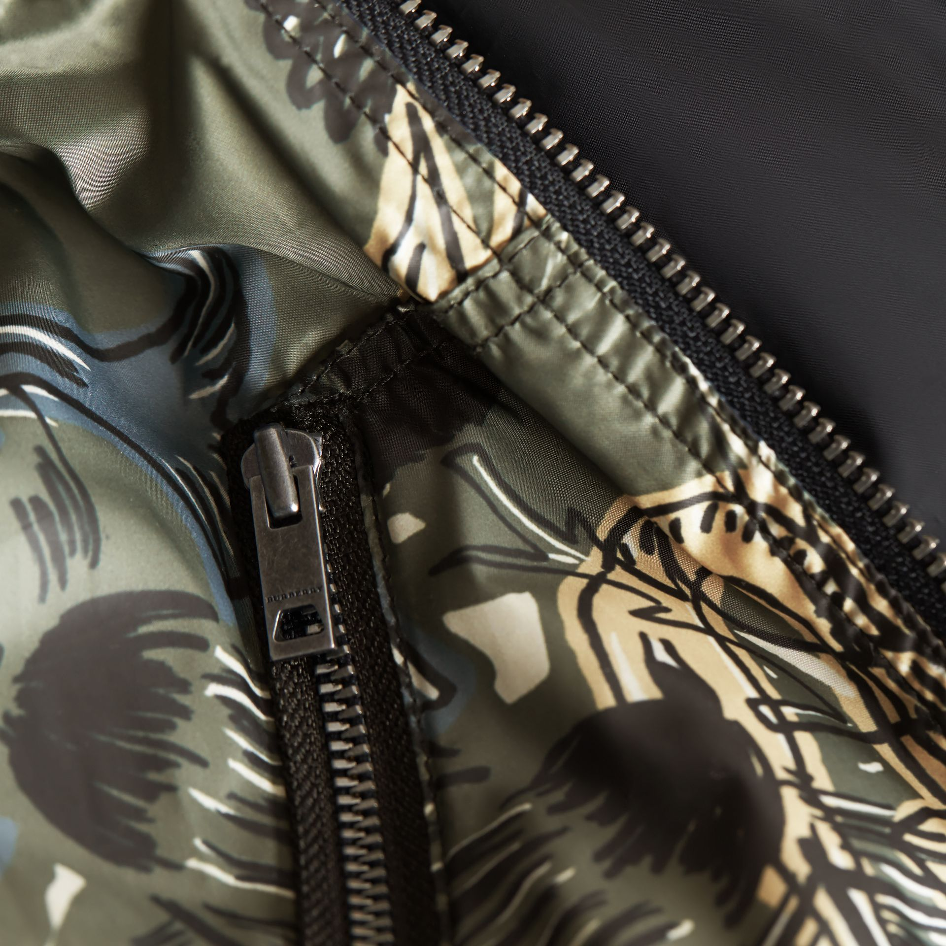 Beasts Print Hooded Bomber Jacket in Sage Green | Burberry - gallery image 1