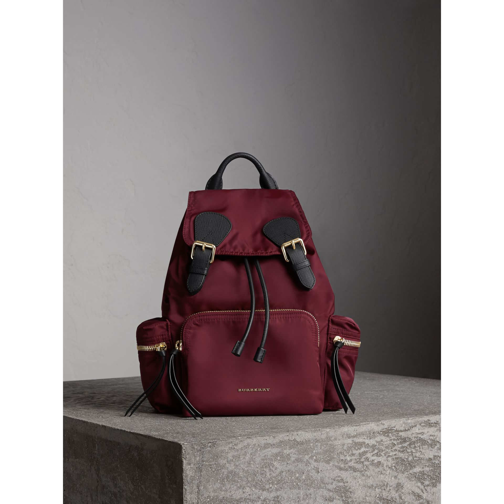 The Medium Rucksack in Technical Nylon and Leather in Burgundy Red - gallery image 1