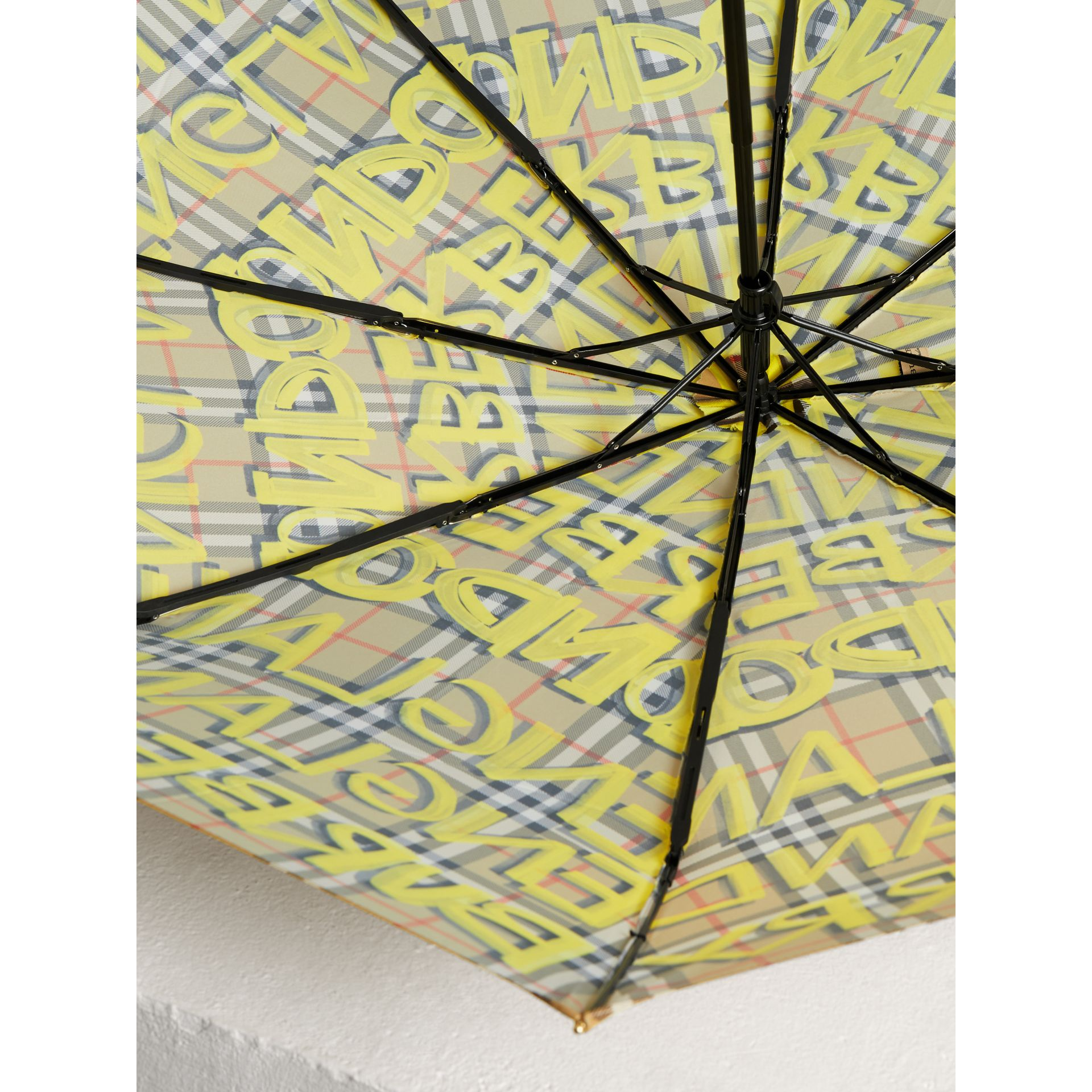 Graffiti Vintage Check Print Folding Umbrella in Yellow | Burberry - gallery image 3