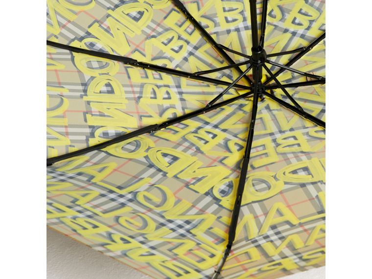 Graffiti Vintage Check Print Folding Umbrella in Yellow | Burberry - cell image 2