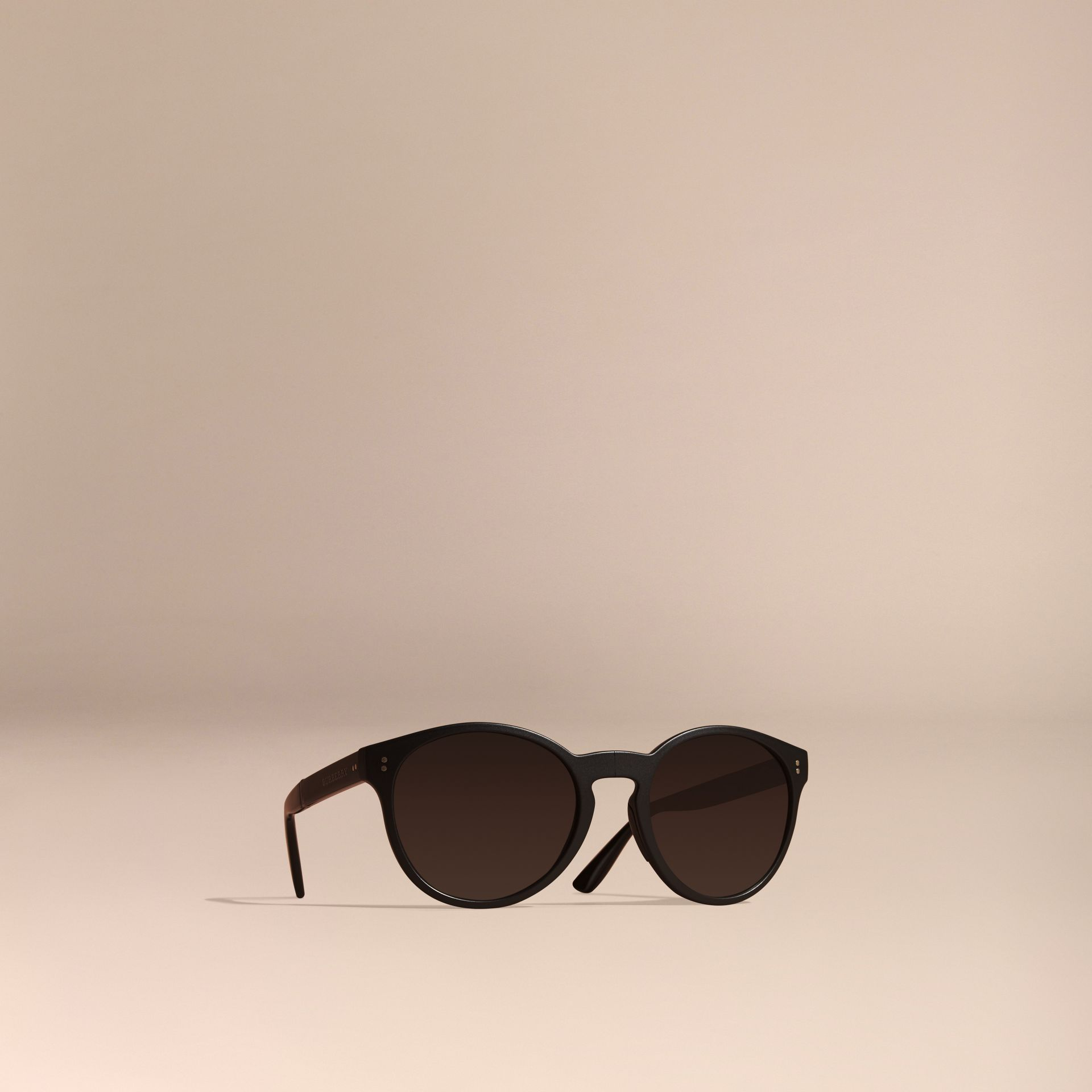 Folding Round Frame Sunglasses in Black - gallery image 1