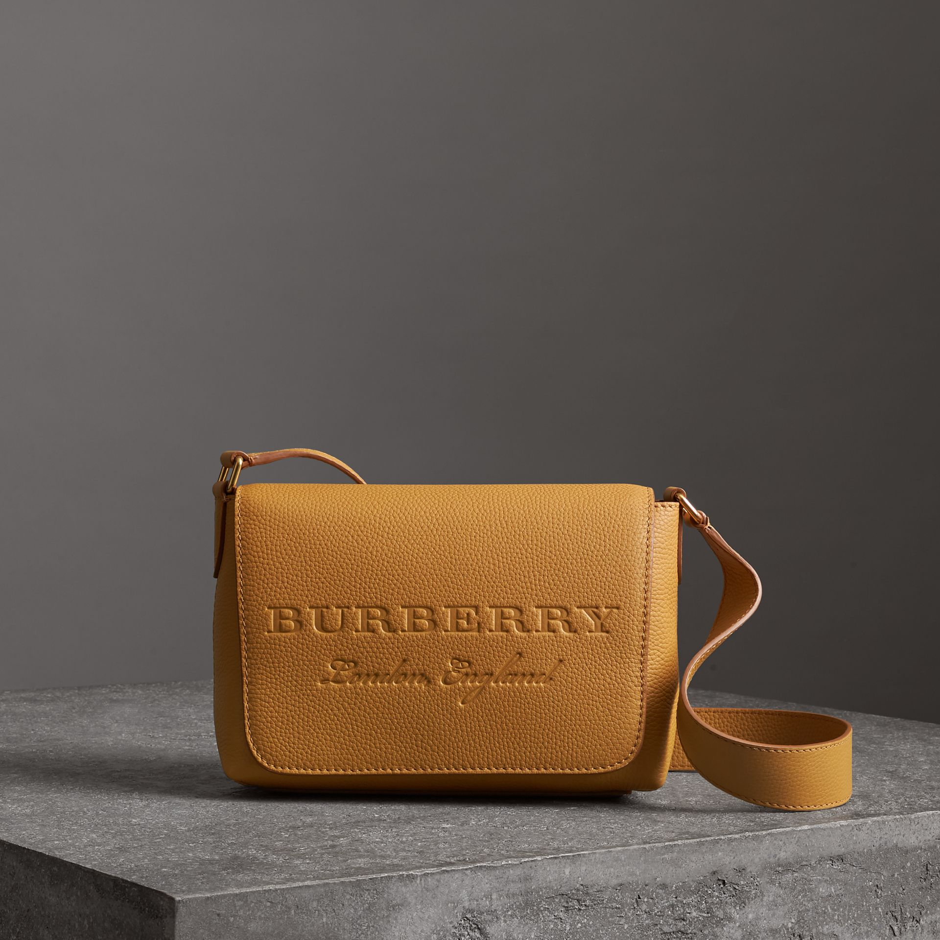 Small Embossed Leather Messenger Bag in Ochre Yellow - Women | Burberry Australia - gallery image 0