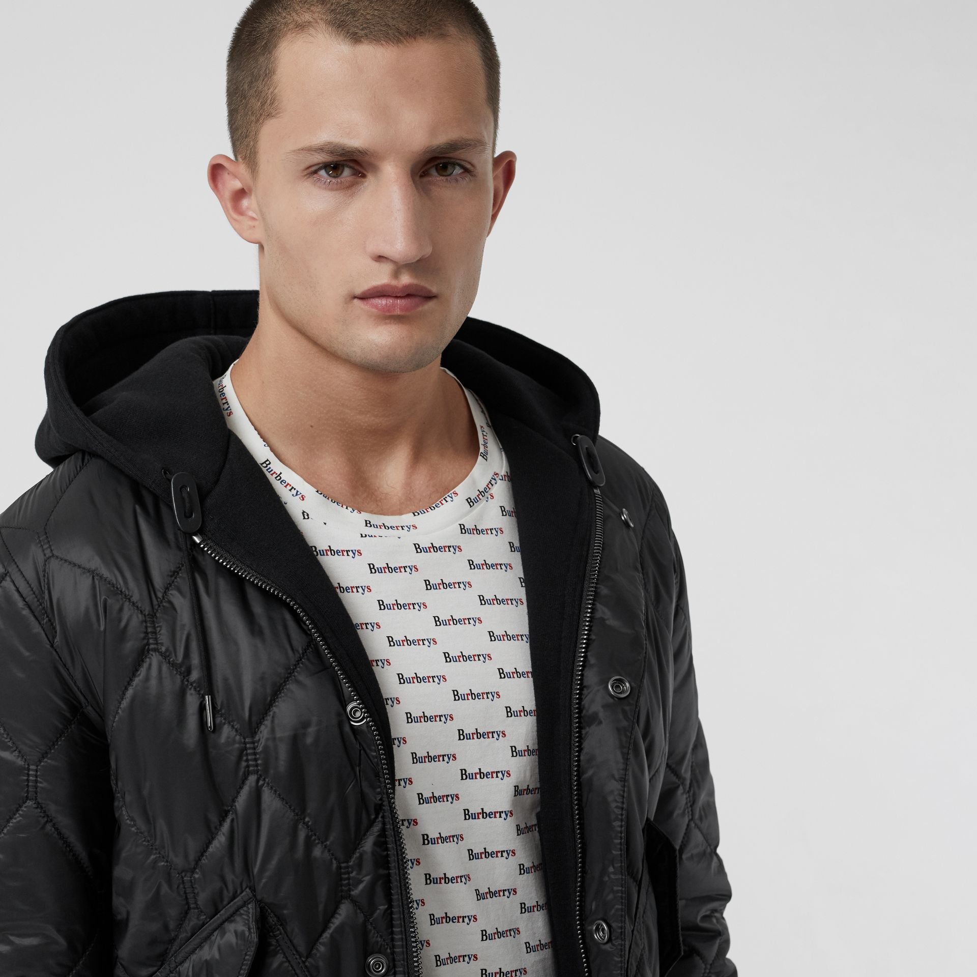 Reversible Diamond Quilted Hooded Jacket in Black - Men | Burberry United Kingdom - gallery image 1