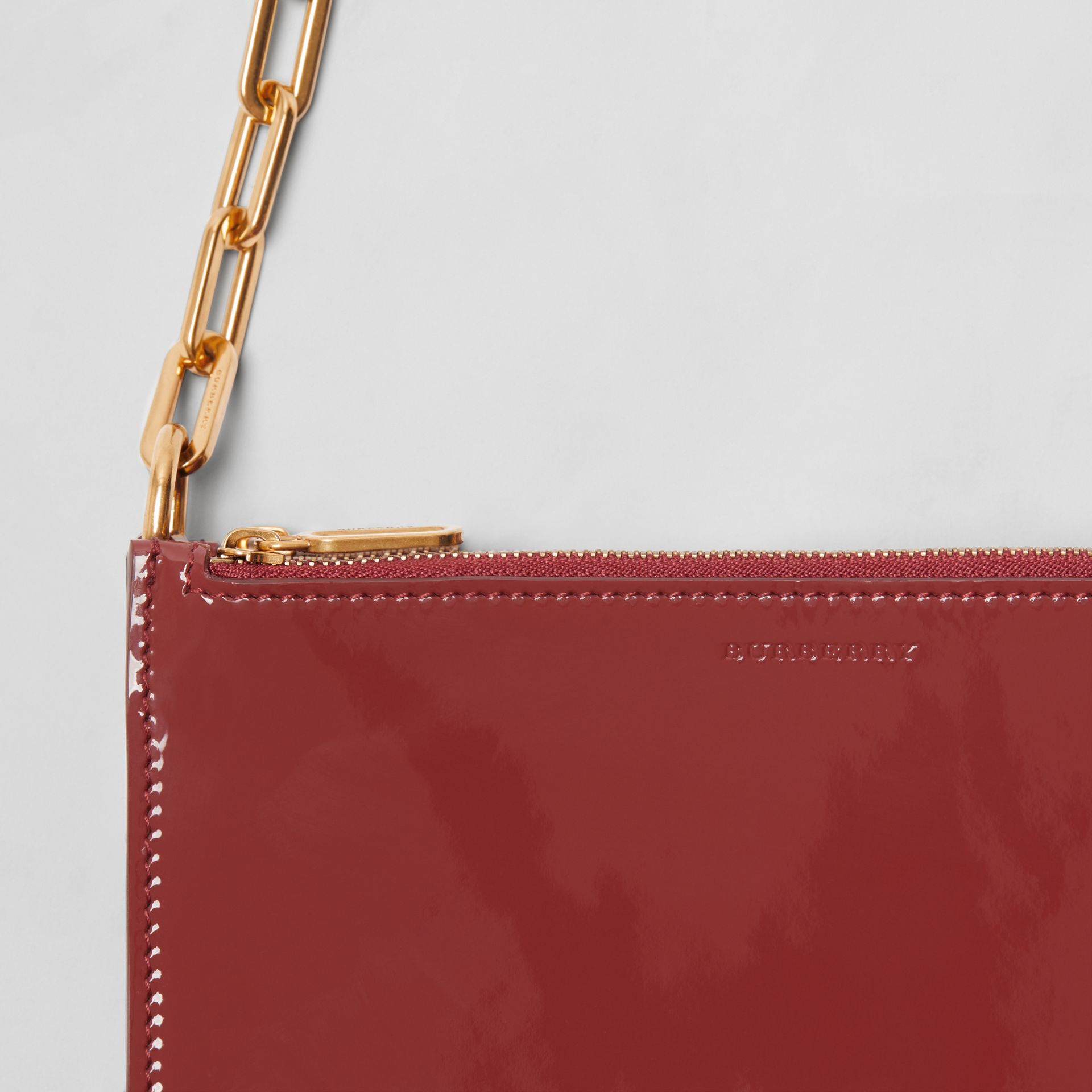 Triple Zip Patent Leather Crossbody Bag in Crimson - Women | Burberry - gallery image 1