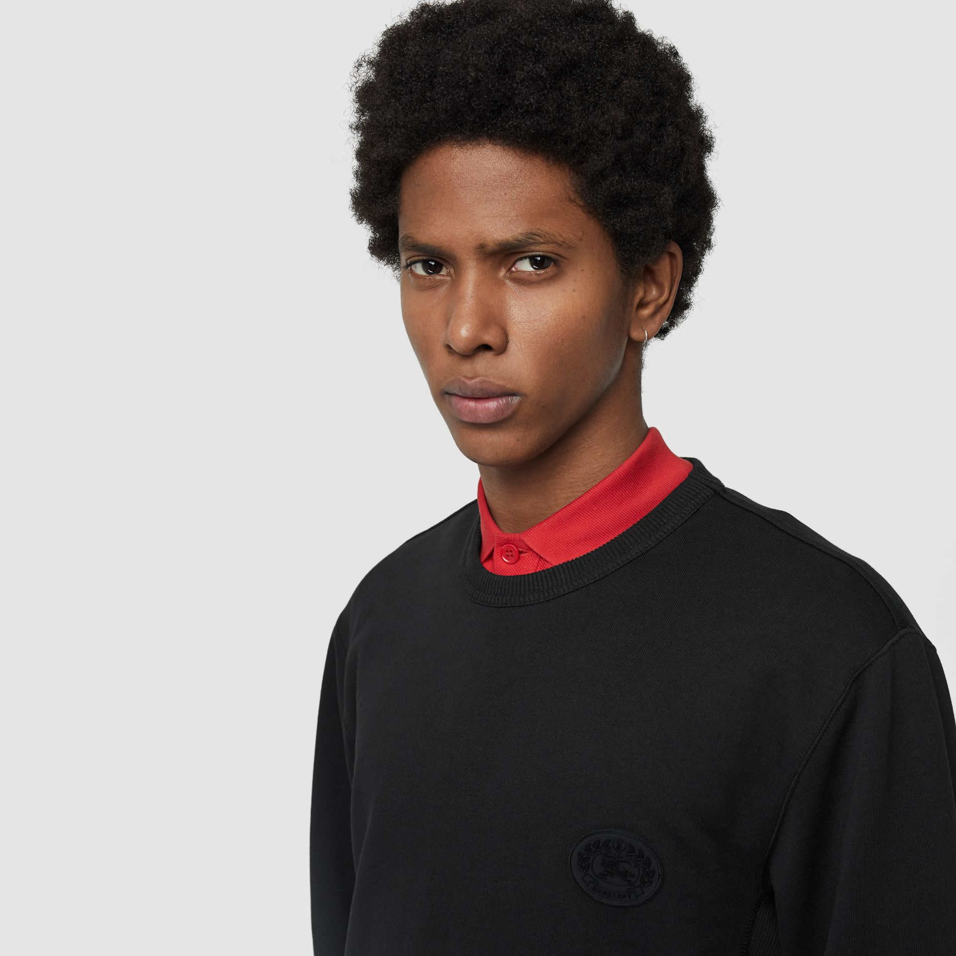 Embroidered Crest Cotton Sweatshirt in Black - Men | Burberry - gallery image 1