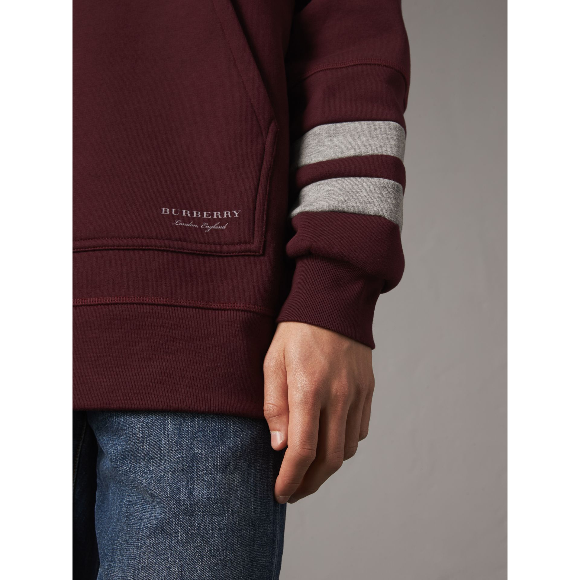 Bold Stripe Detail Oversize Hooded Sweatshirt in Deep Claret - Men | Burberry - gallery image 2