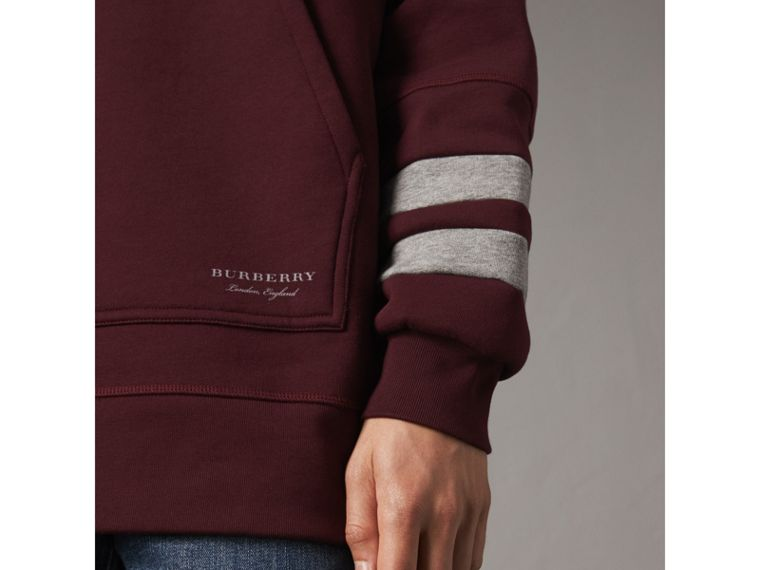 Bold Stripe Detail Oversize Hooded Sweatshirt in Deep Claret - Men | Burberry United Kingdom - cell image 1