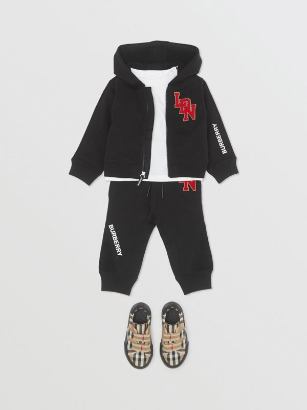 Logo Graphic Cotton Trackpants in Black - Children | Burberry United Kingdom - cell image 2