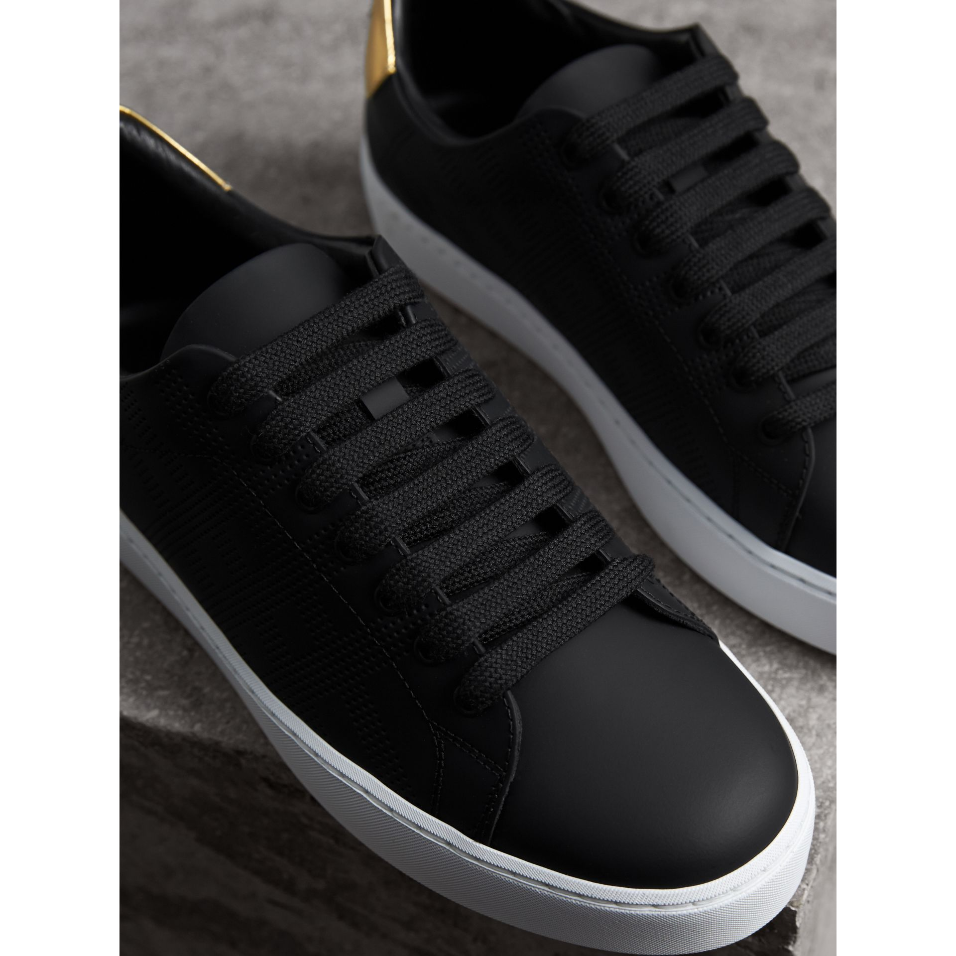 Perforated Check Leather Trainers in Black - Women | Burberry - gallery image 5