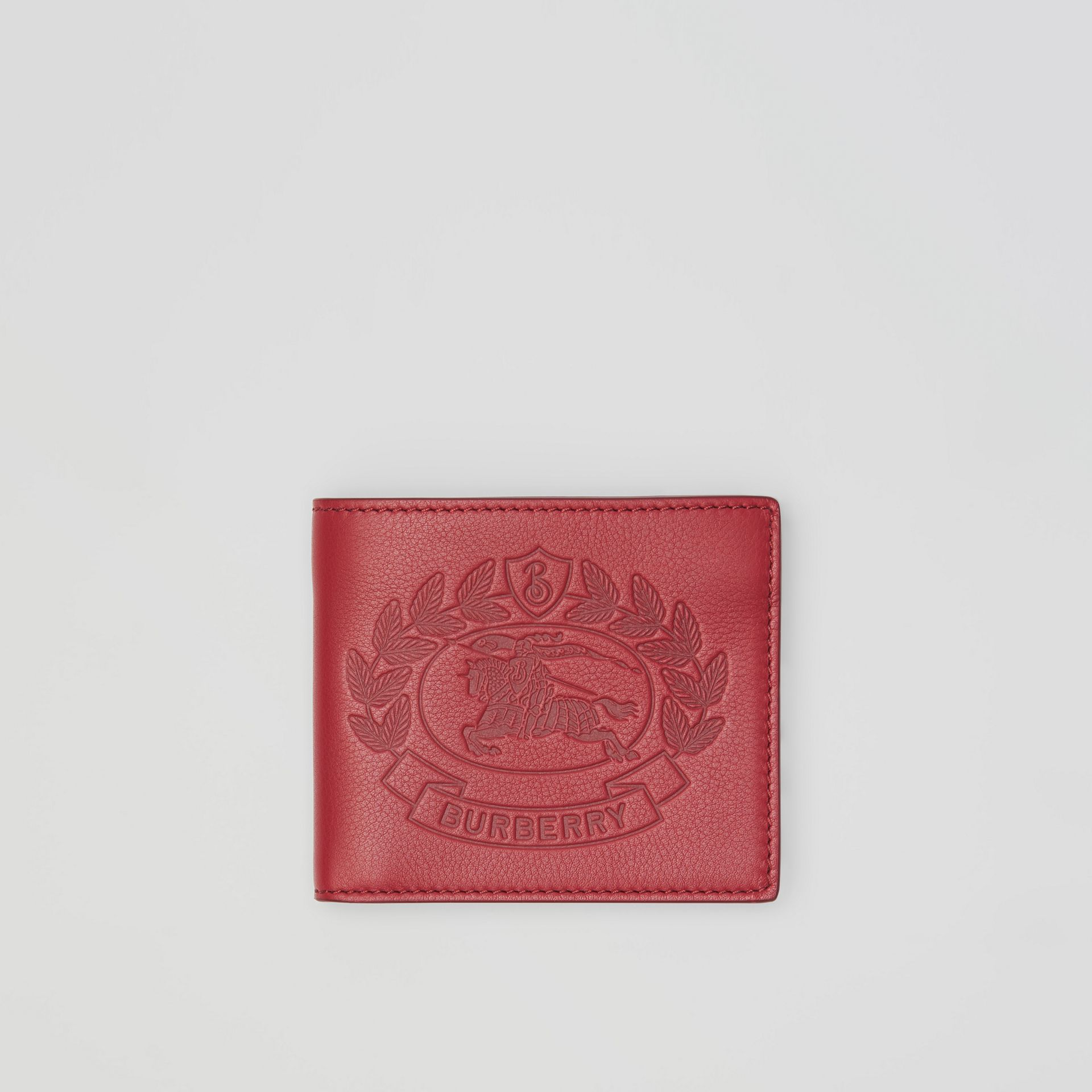 Embossed Crest Leather International Bifold Wallet in Crimson - Men | Burberry Australia - gallery image 0
