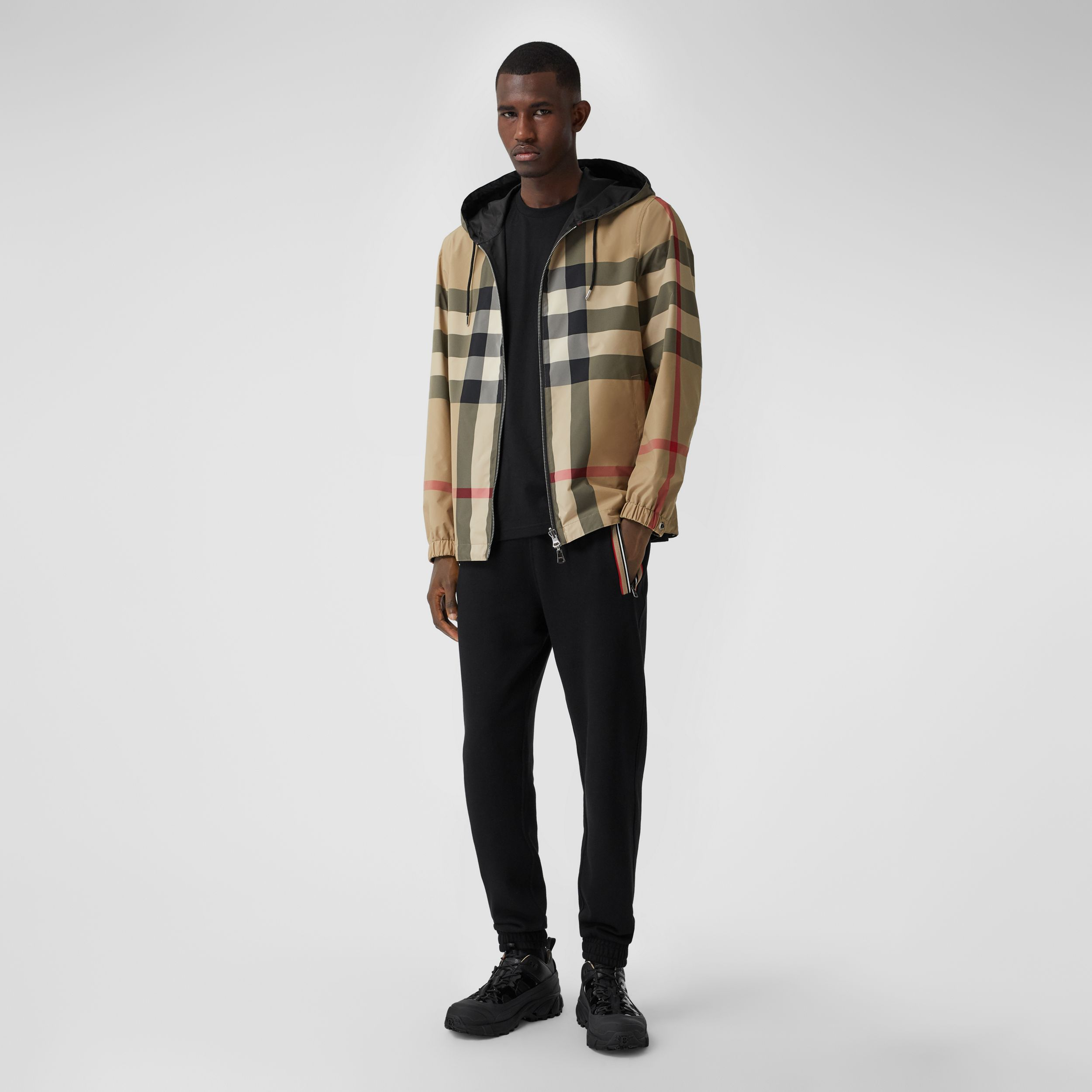 Reversible Check Recycled Polyester and ECONYL® Jacket in Archive Beige - Men | Burberry - 1