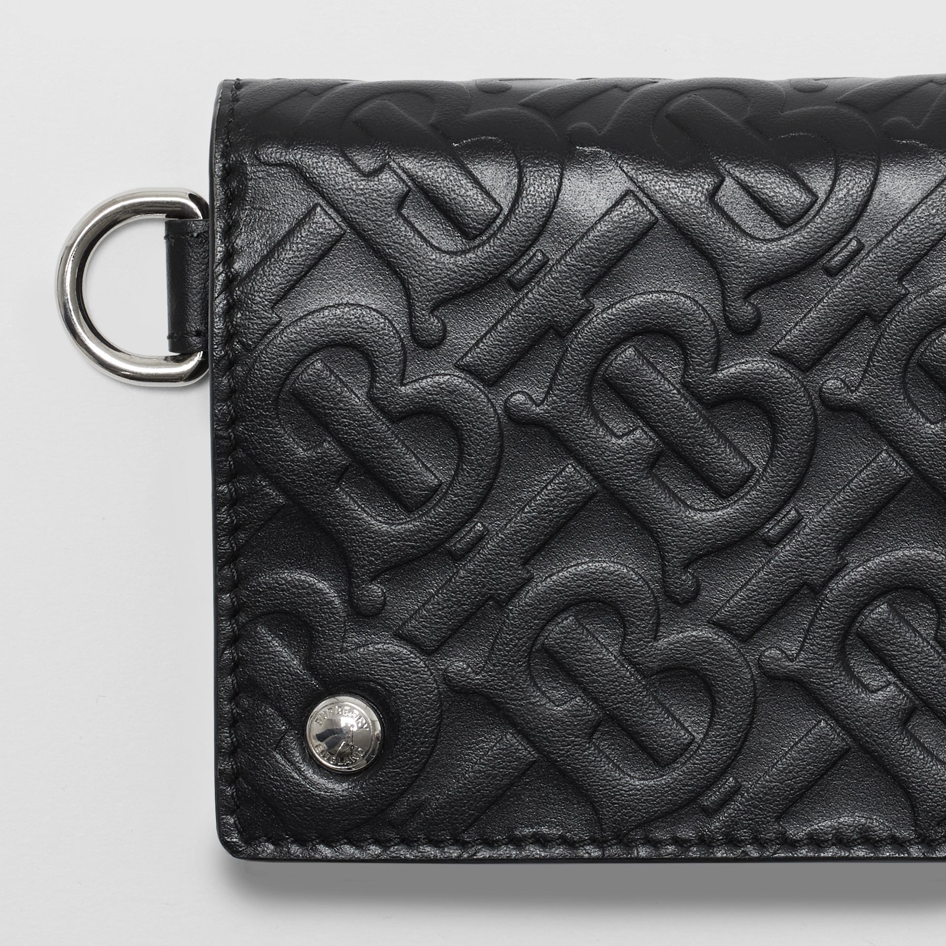 Monogram Embossed Leather Trifold Wallet in Black - Men | Burberry - gallery image 1