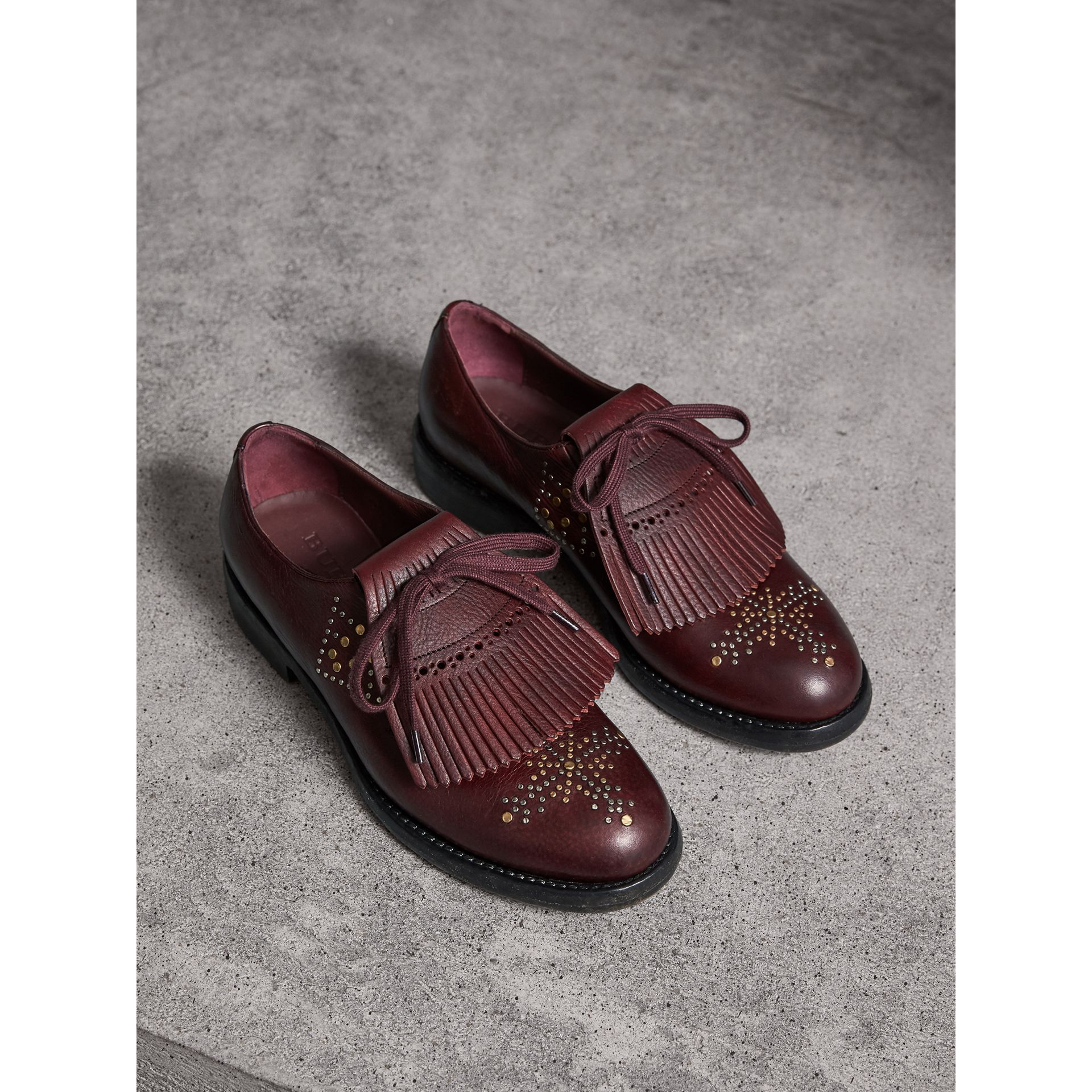 Lace-up Kiltie Fringe Riveted Leather Loafers in Cerise Purple - Women | Burberry - gallery image 1
