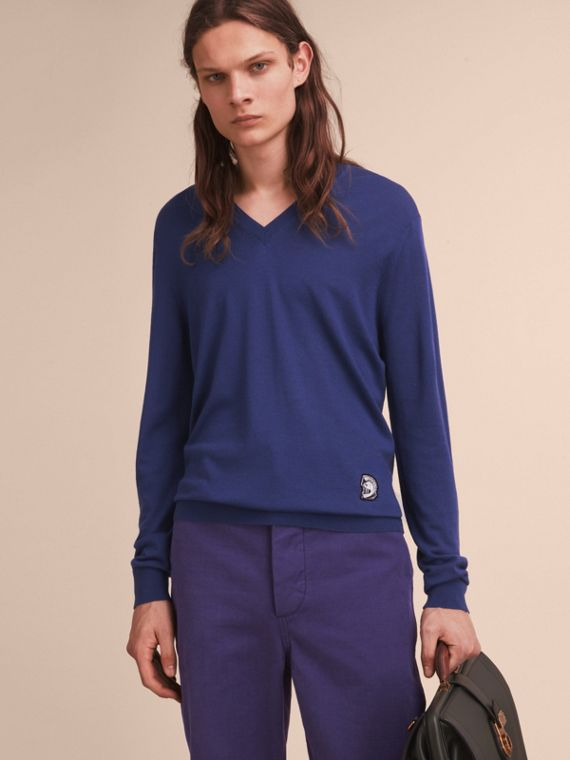 Pallas Helmet Motif Merino Wool V-neck Sweater in Indigo Blue