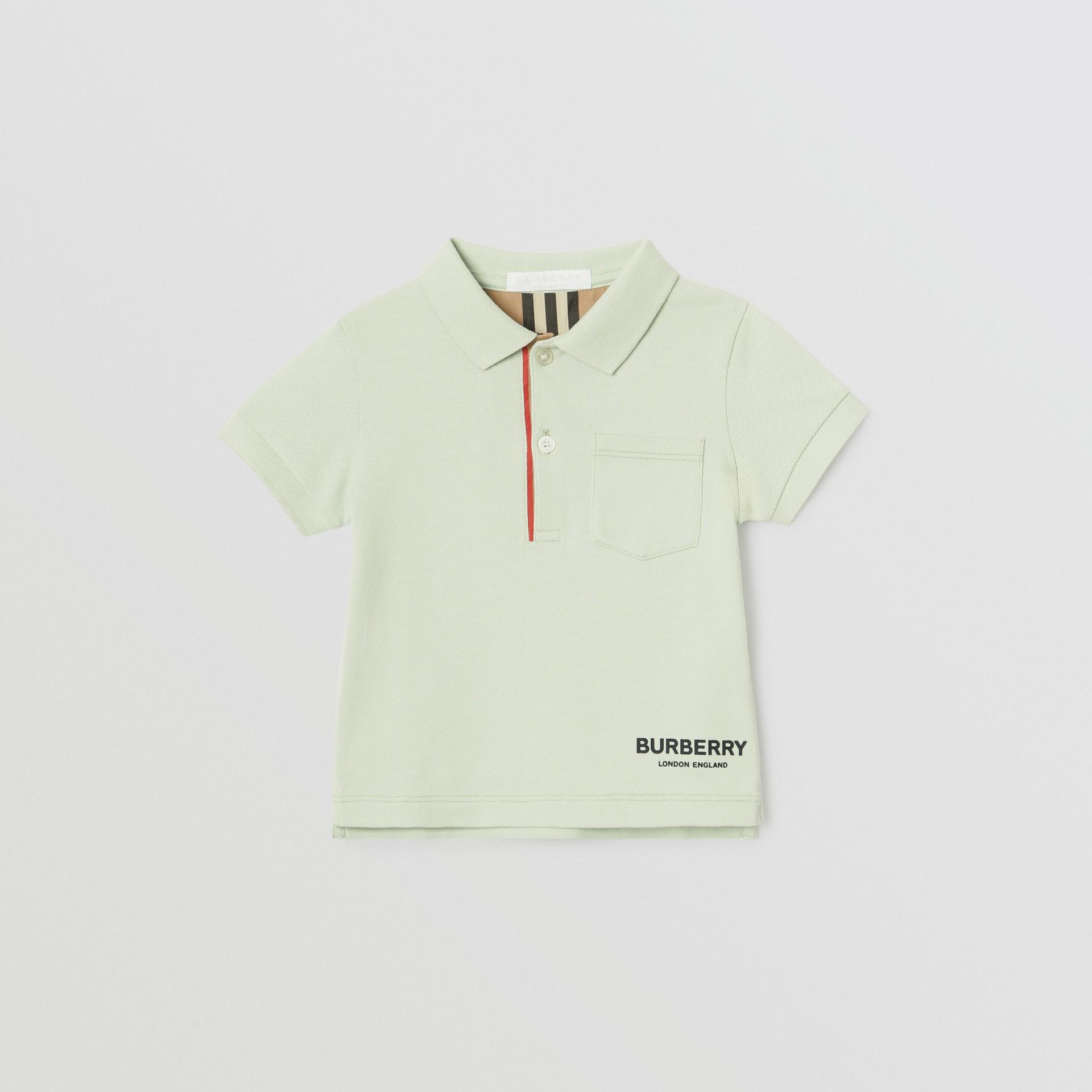 Polo in cotone piqué con iconico motivo a righe sulla paramontura (Menta Pallido) - Bambino | Burberry - immagine della galleria 0