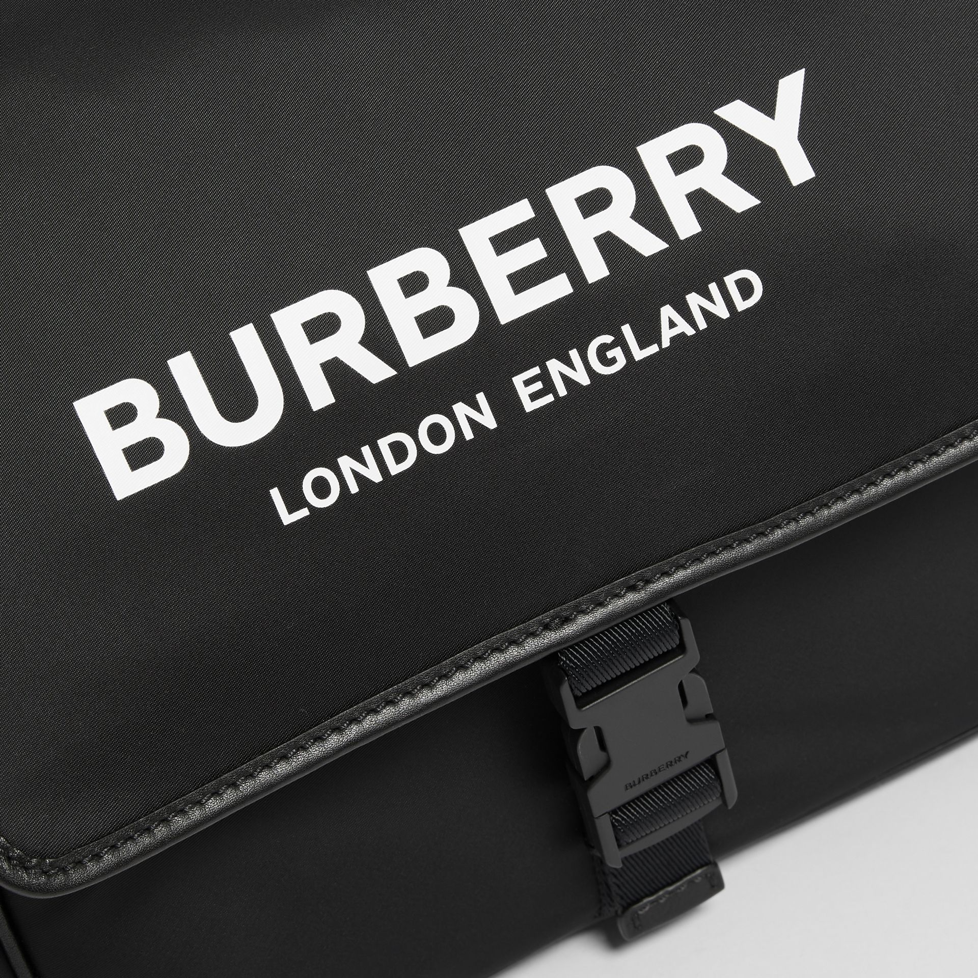 Logo Print Baby Changing Bag in Black - Children | Burberry United Kingdom - gallery image 1