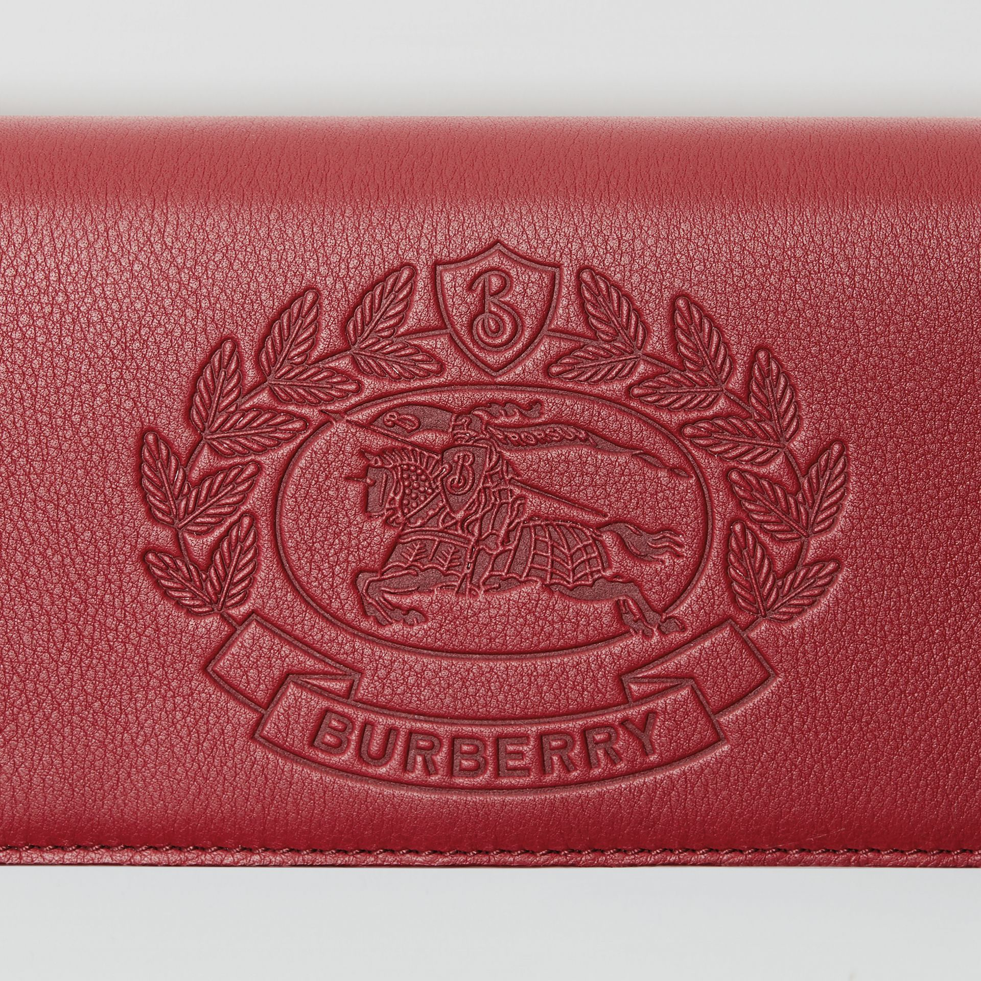 Embossed Crest Leather Continental Wallet in Crimson - Men | Burberry - gallery image 1