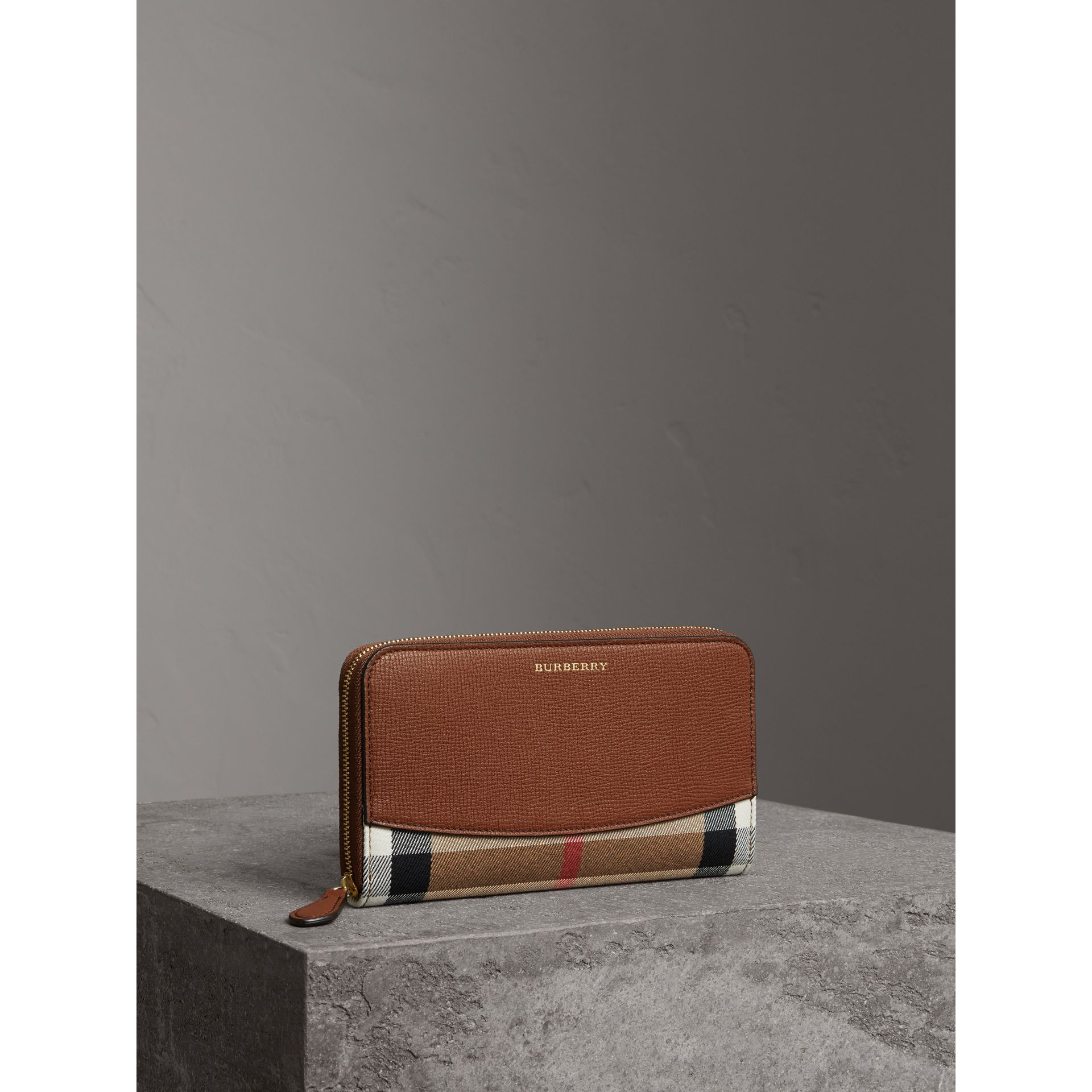 House Check and Leather Ziparound Wallet in Brown Ochre - Women | Burberry - gallery image 0